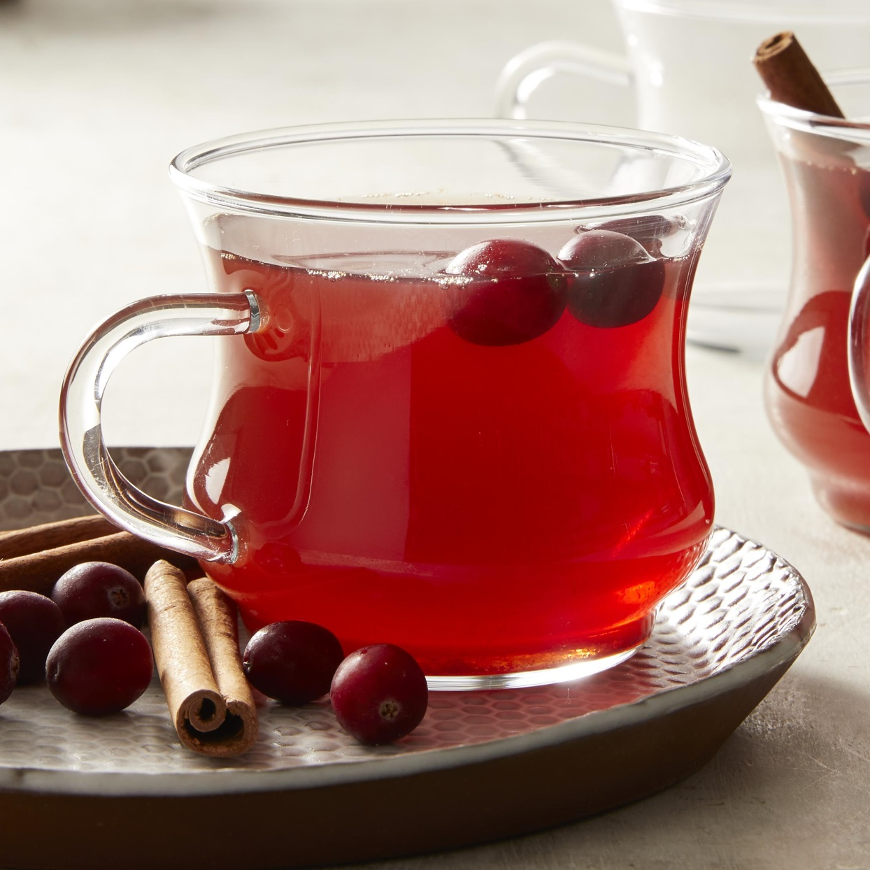 Orange zest and cinnamon infuse this warm apple-cranberry drink with lots of holiday flavor.