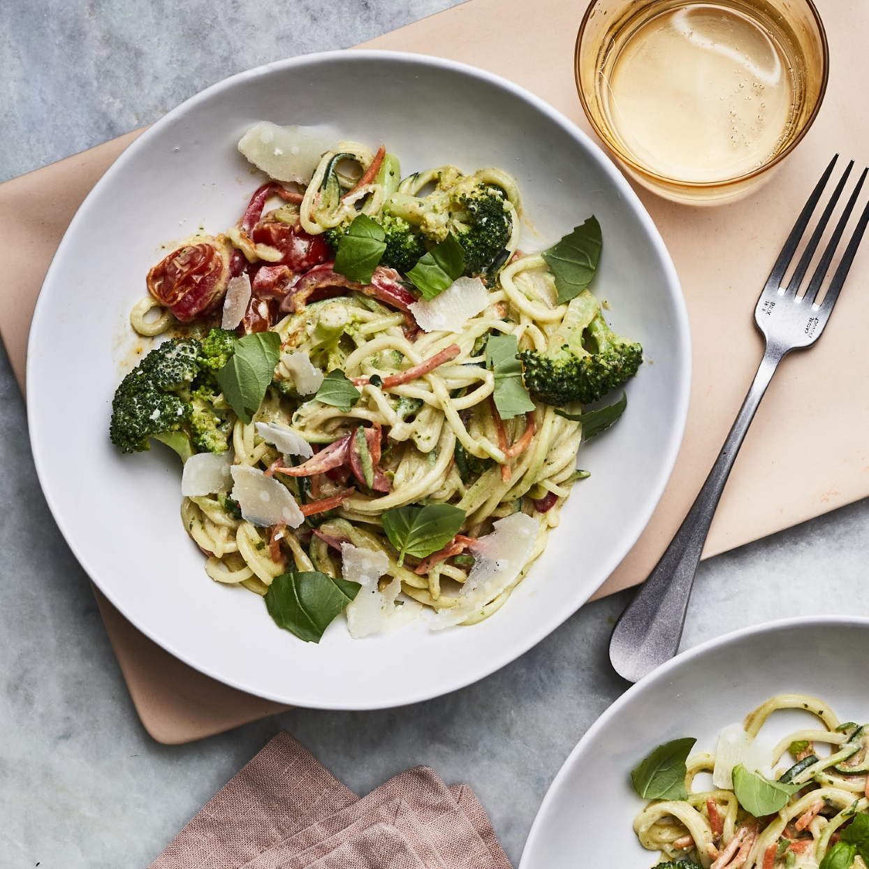 "This primavera recipe cuts carbs by swapping out the pasta for zucchini ""noodles."" This quick vegetarian dinner is chock-full of colorful vegetables smothered in a light, creamy sauce. We like using prepackaged spiralized zucchini noodles to keep this recipe ultra-fast, but if you have a spiralizer and zucchini on hand, you can easily make your own. Source: EatingWell.com, January 2020"