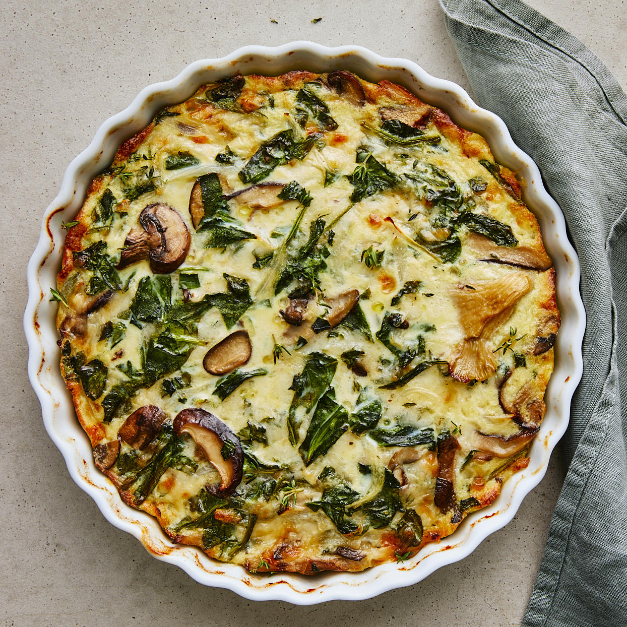 This healthy vegetarian quiche recipe is as simple as it gets. It's a quiche without the fussy crust! It's filled with sweet wild mushrooms and savory Gruyère cheese. Enjoy it for breakfast or brunch, or serve it with a light salad for lunch. Source: EatingWell.com, January 2020