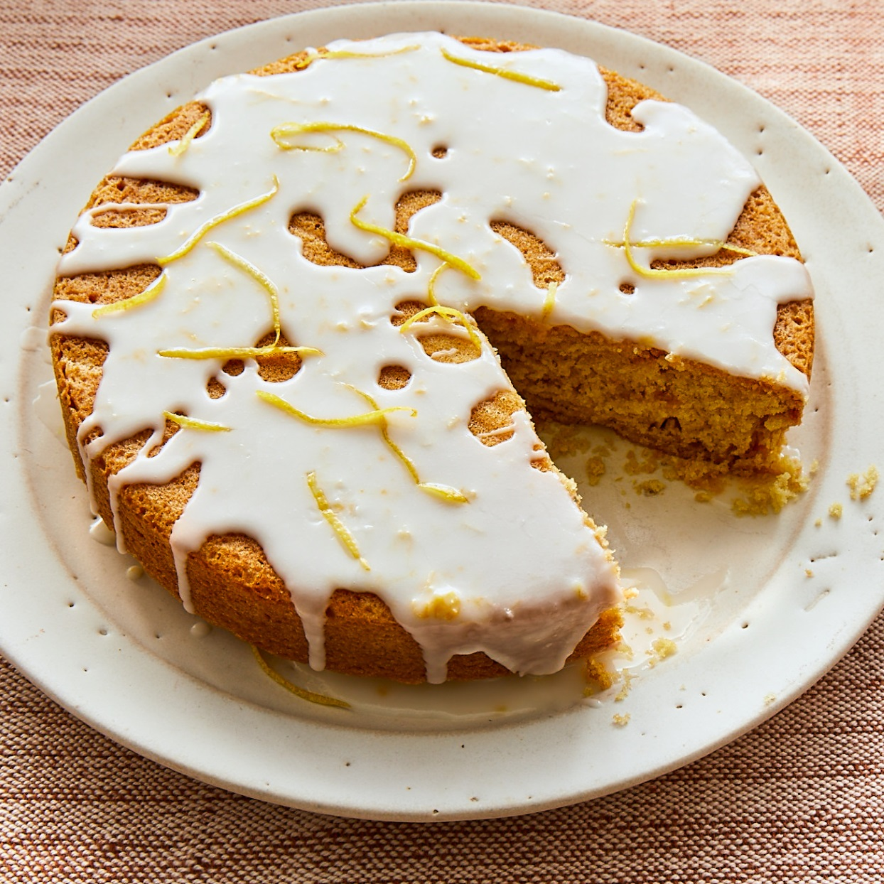 You don't have to be vegan to enjoy this vegan lemon cake! It's moist, delicious and plenty lemony thanks to a combination of lemon juice and zest. A glaze made with lemon juice, confectioners' sugar and almond milk adds a sweet-tangy finish.