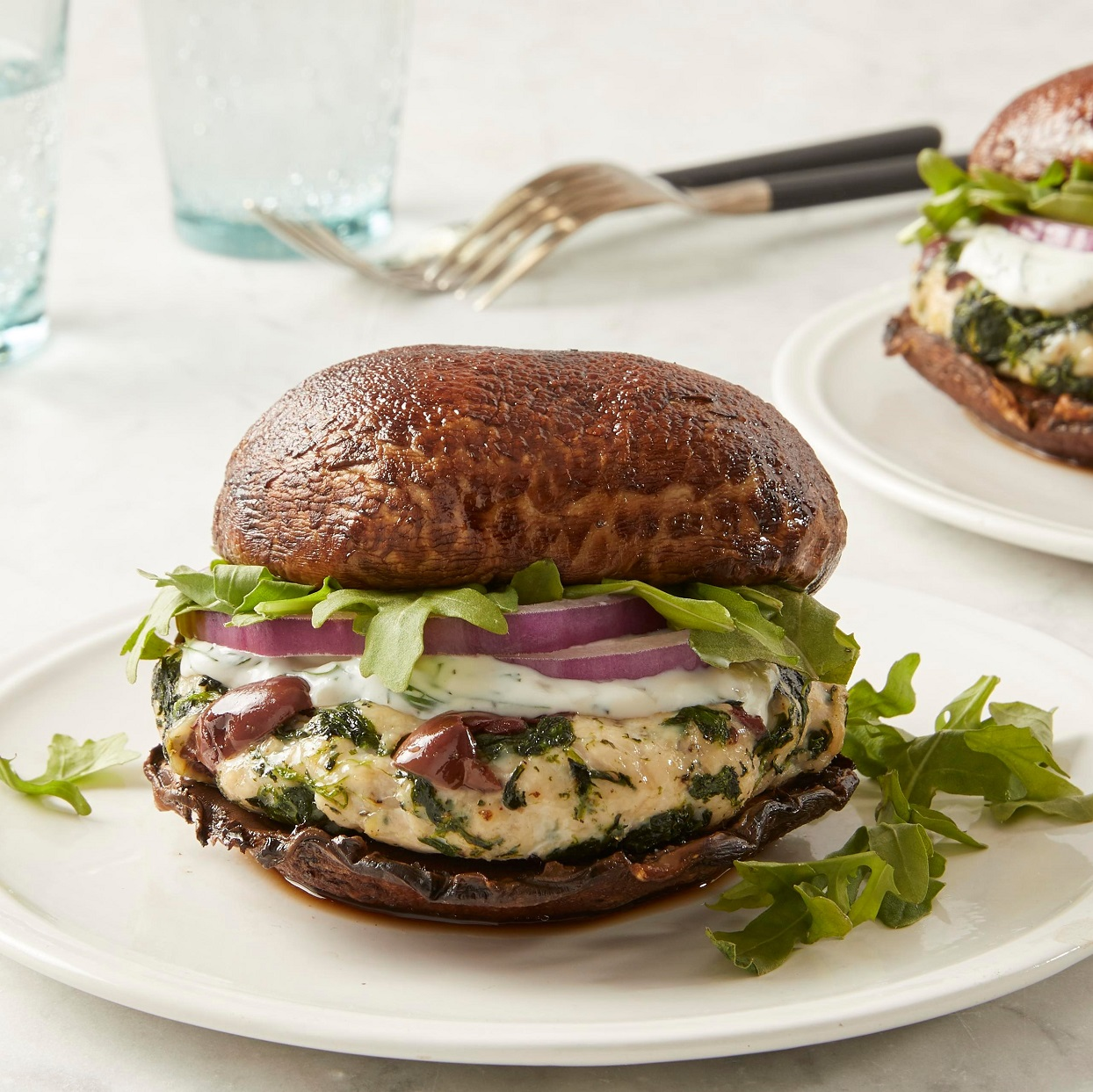 This low-carb burger replaces the typical bun with roasted portobello mushroom caps. Creamy tzatziki and crisp sliced red onion add texture and flavor to this easy Greek-inspired burger recipe. Source: EatingWell.com, January 2020
