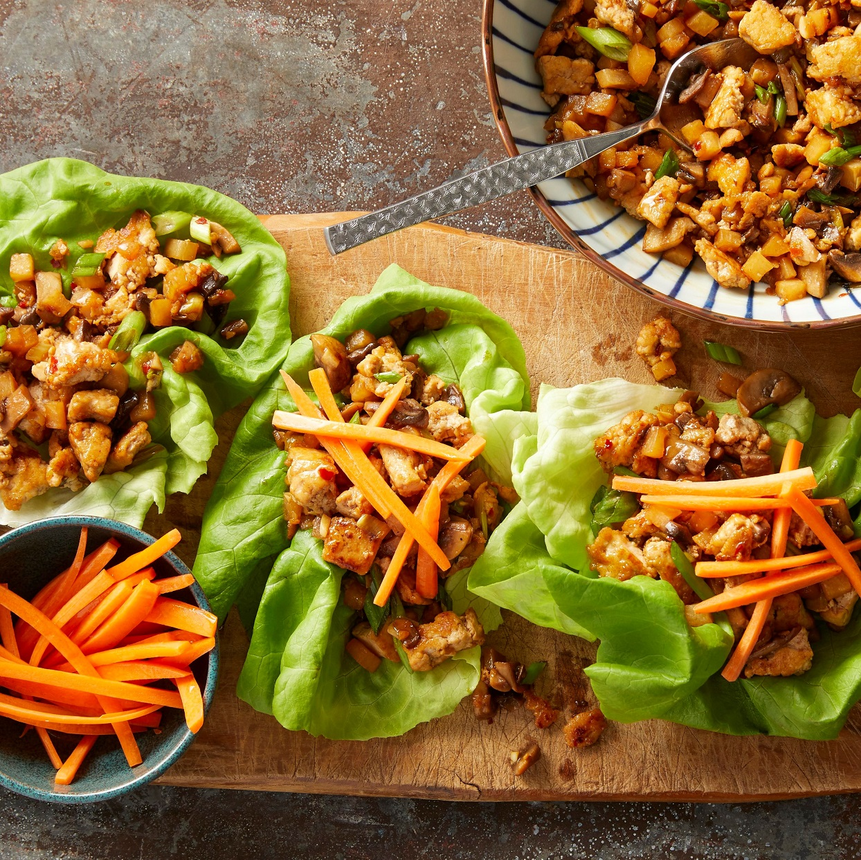 Stuff crisp lettuce leaves with a savory filling inspired by PF Chang's famous lettuce wraps. These low-carb wraps made with tofu, mushrooms and daikon radish are an easy vegetarian dinner that beats takeout! Garnish the wraps with julienned carrots for added crunch.