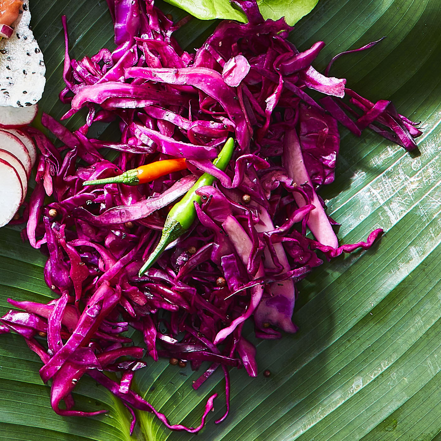 """""""Sour flavors are important in Filipino cooking, and quick pickles both heighten the sourness and serve as palate-cleansers, balancing and cutting through fattier dishes,"""" says Yana Gilbuena. """"This cold-flash-pickling method works with all kinds of vegetables, but red cabbage is an easy and gorgeous place to start."""""""