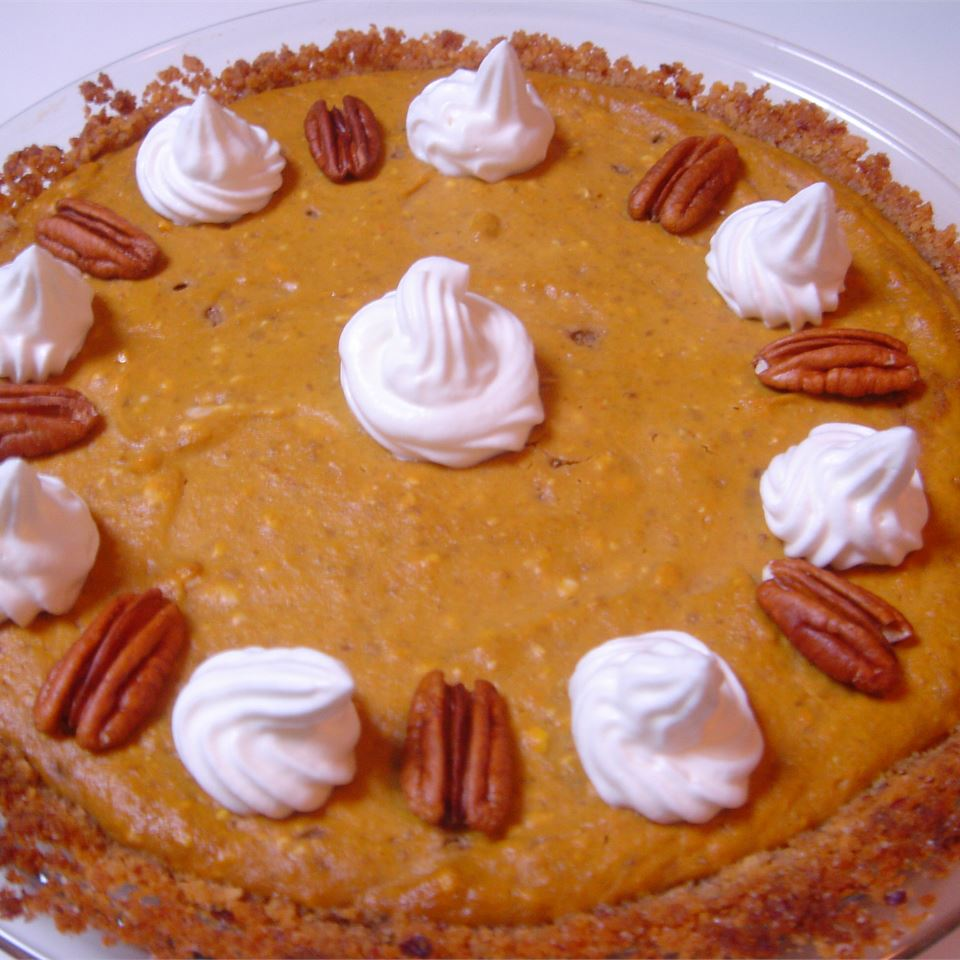 """""""My family doesn't care for pumpkin pie but loved this smooth, creamy version of it...Unlike a cheesecake, you don't really taste the cream cheese, but I'm sure that's what makes this pie a cut above the traditional pumpkin pie,"""" says reviewer sadie."""