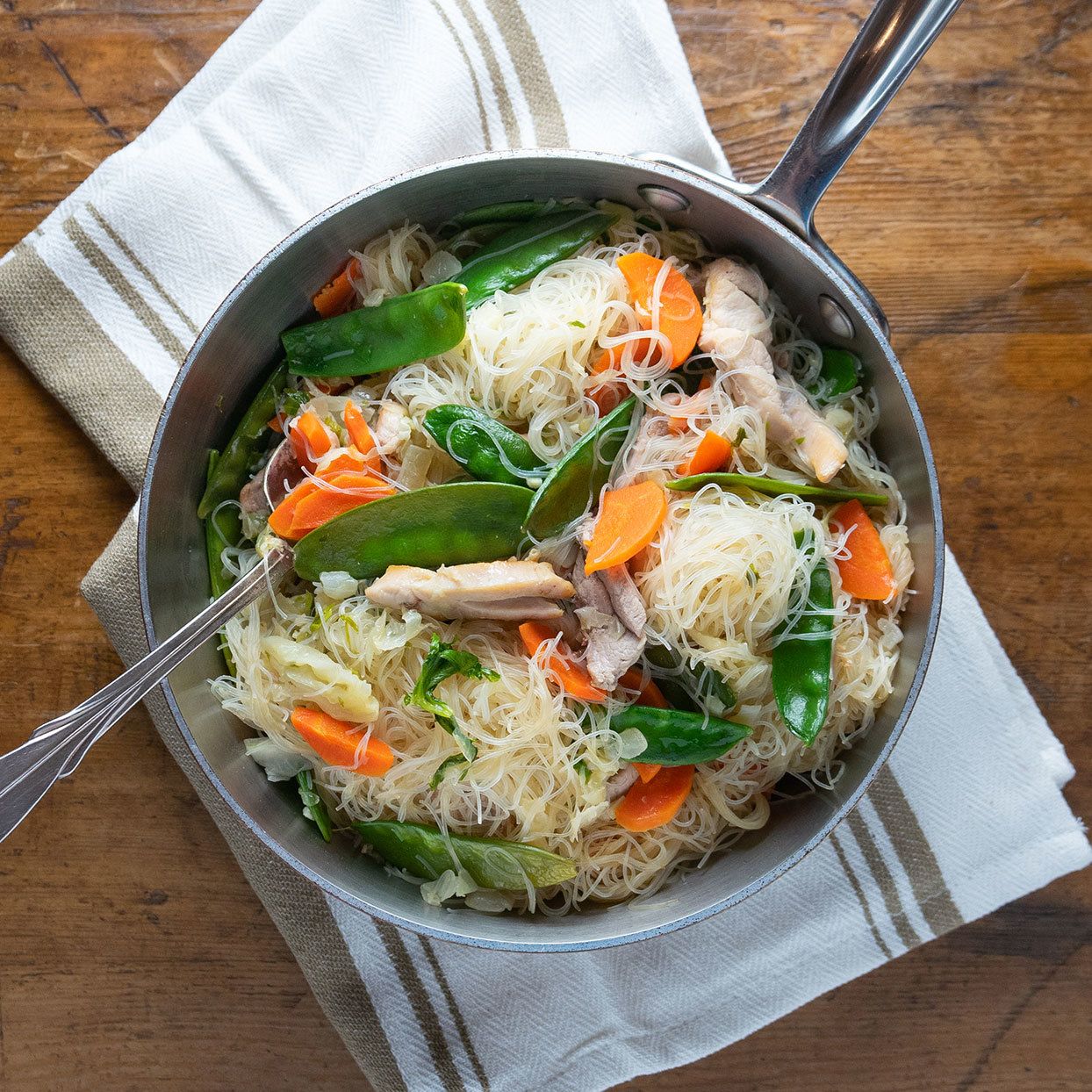 This healthy version of the classic Filipino noodle dish pancit bihon has plenty of vegetables, along with chicken and pork. And since it comes together in about a half-hour, this traditional party food can do double duty as an easy weeknight dinner. Source: EatingWell.com, January 2020