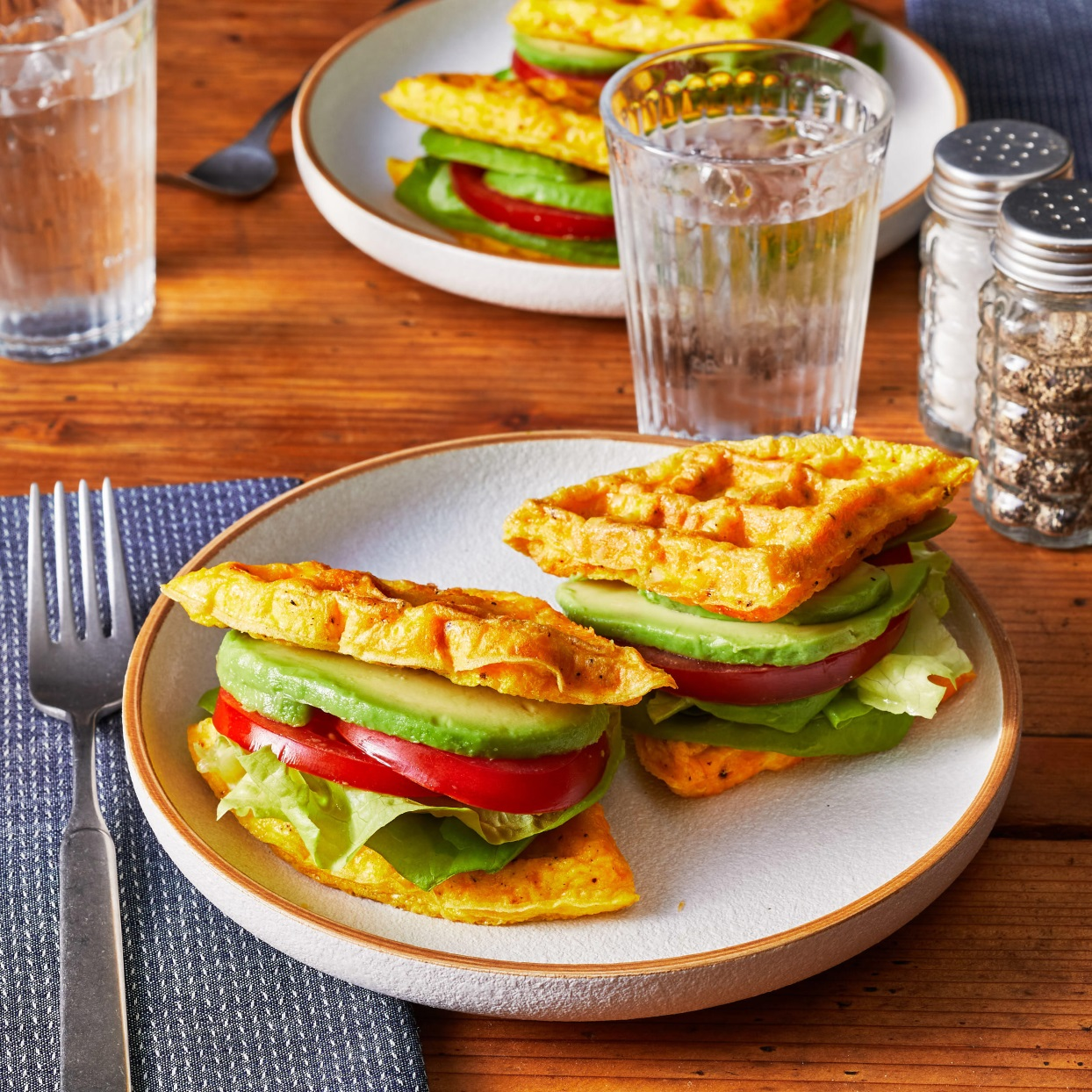 "You don't have to be on a low-carb or Keto diet to jump on the ""chaffle"" trend--chaffles are flourless waffles made from eggs and cheese. They may be gimmicky, but they're also delicious. For our chaffle sandwiches, we've added some crumbled bacon to the batter and used the chaffles to make sandwiches, filled with avocado and tomato. Enjoy a sandwich as a low-carb breakfast that also happens to be gluten-free. Source: EatingWell.com, January 2020"