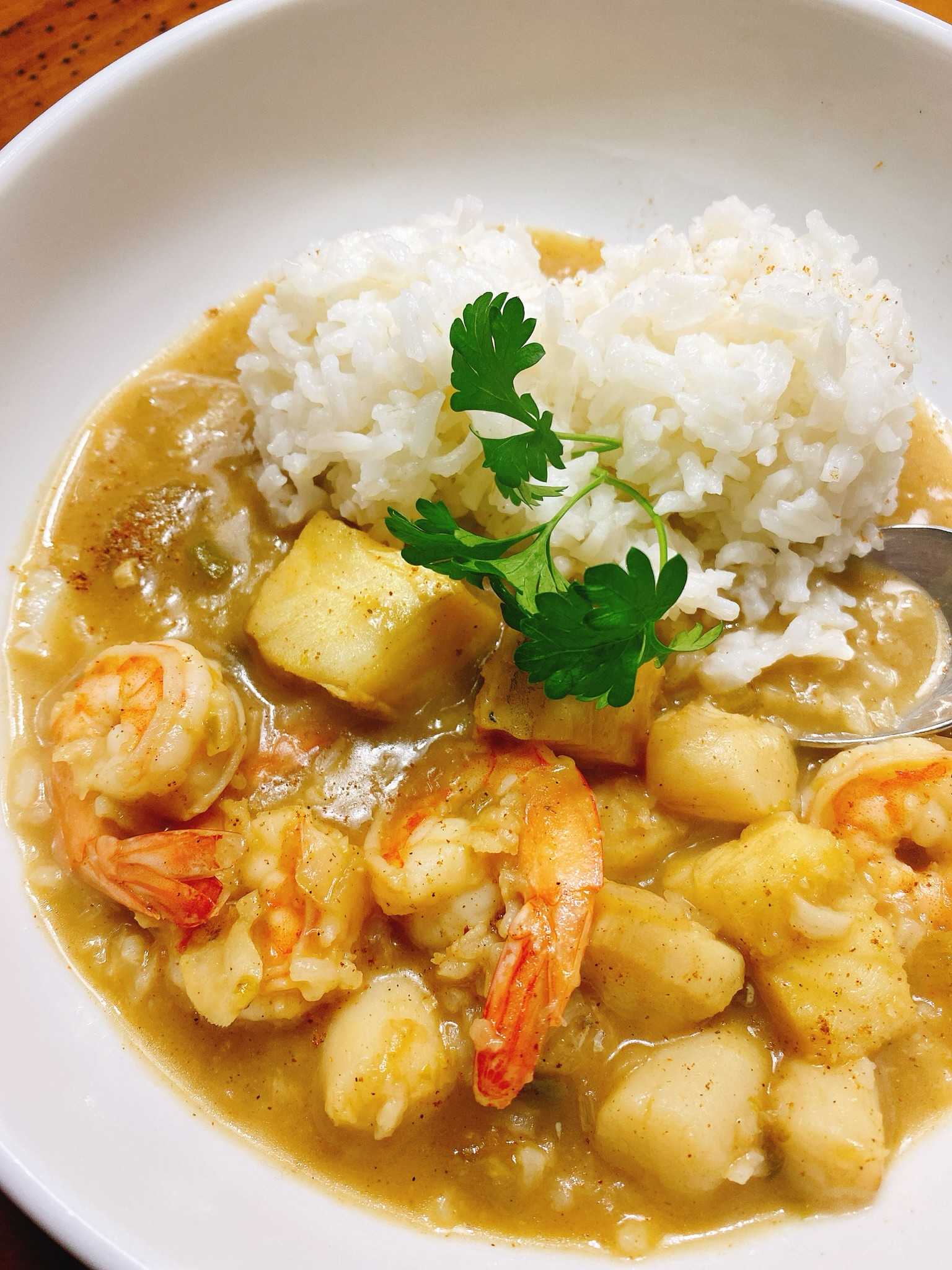 """""""I took one of my favorite gumbo recipes and converted it to cook in the Instant Pot,"""" says recipe creator thedailygourmet. """"Chock-full of shrimp, scallops, and cod, it is cooked in a roux that incorporates Louisiana beer."""""""