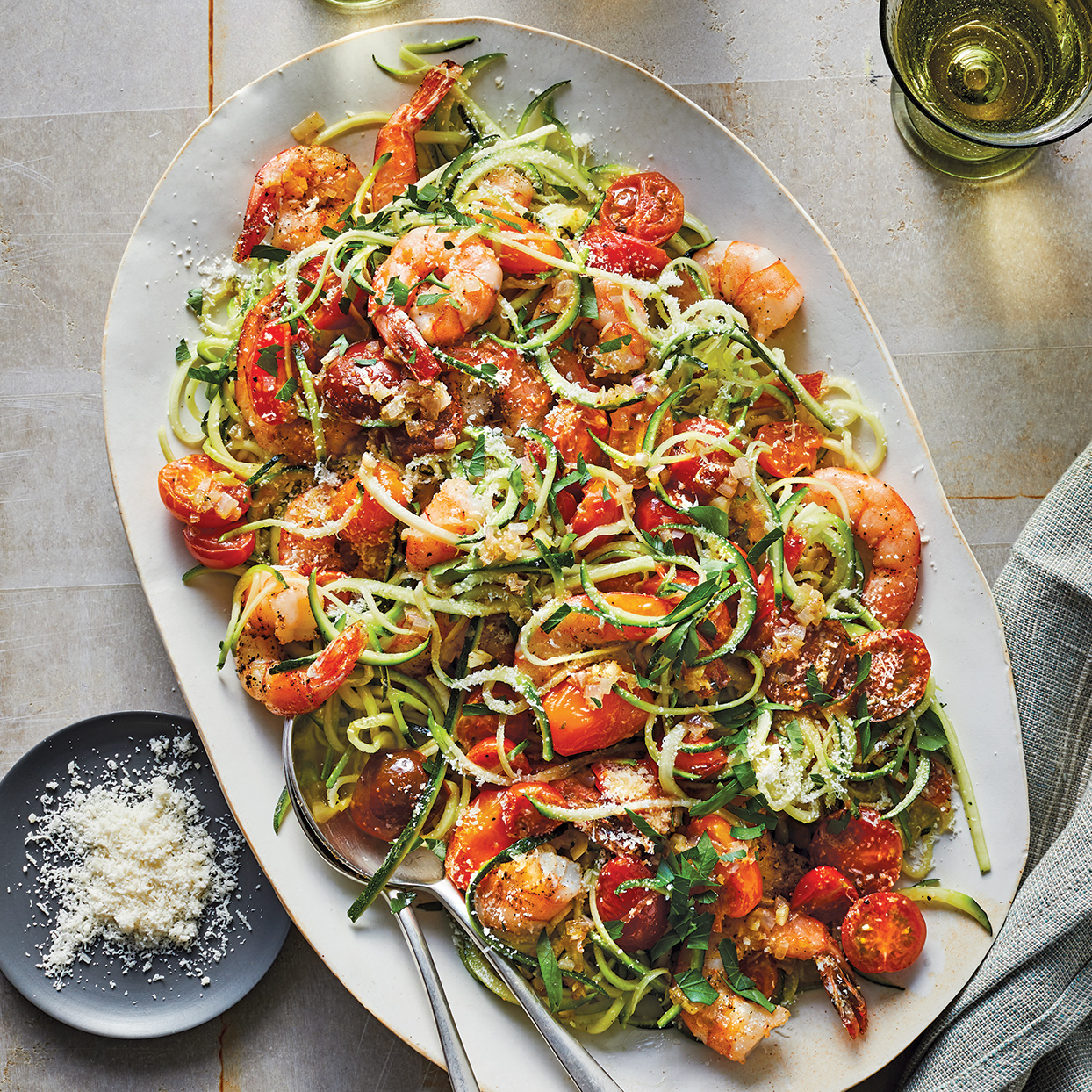 Enjoy classic shrimp scampi lightened up with a white wine-butter sauce and zucchini noodles in place of pasta. The tomatoes add some sweetness and color, while the cheese contributes nuttiness and richness. Source: 400 Calorie Recipes