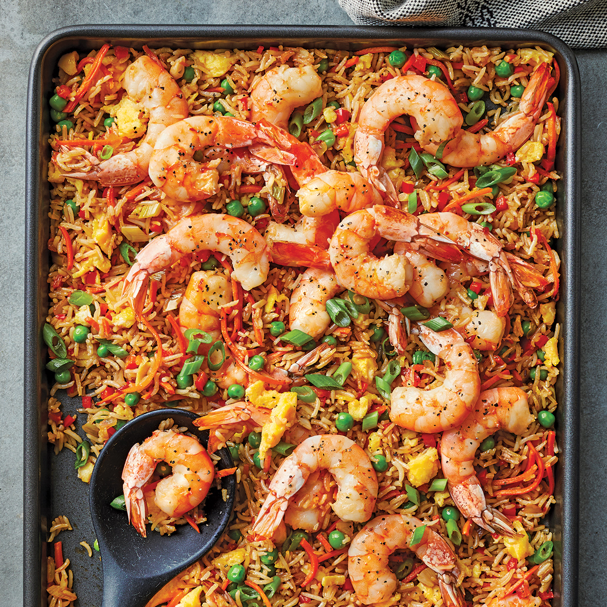 Classic shrimp fried rice gets amped-up flavor with sambal heat. The textures are pretty spot on with hits of crispy and tender rice and are the same as you'd get if you prepared it in a wok or skillet. This sheet-pan shrimp fried rice recipe is a great way to use leftover rice, but you could also use pre-cooked microwave rice so that it can be coming to room temperature while you chop the veggies. Source: 400 Calorie Recipes