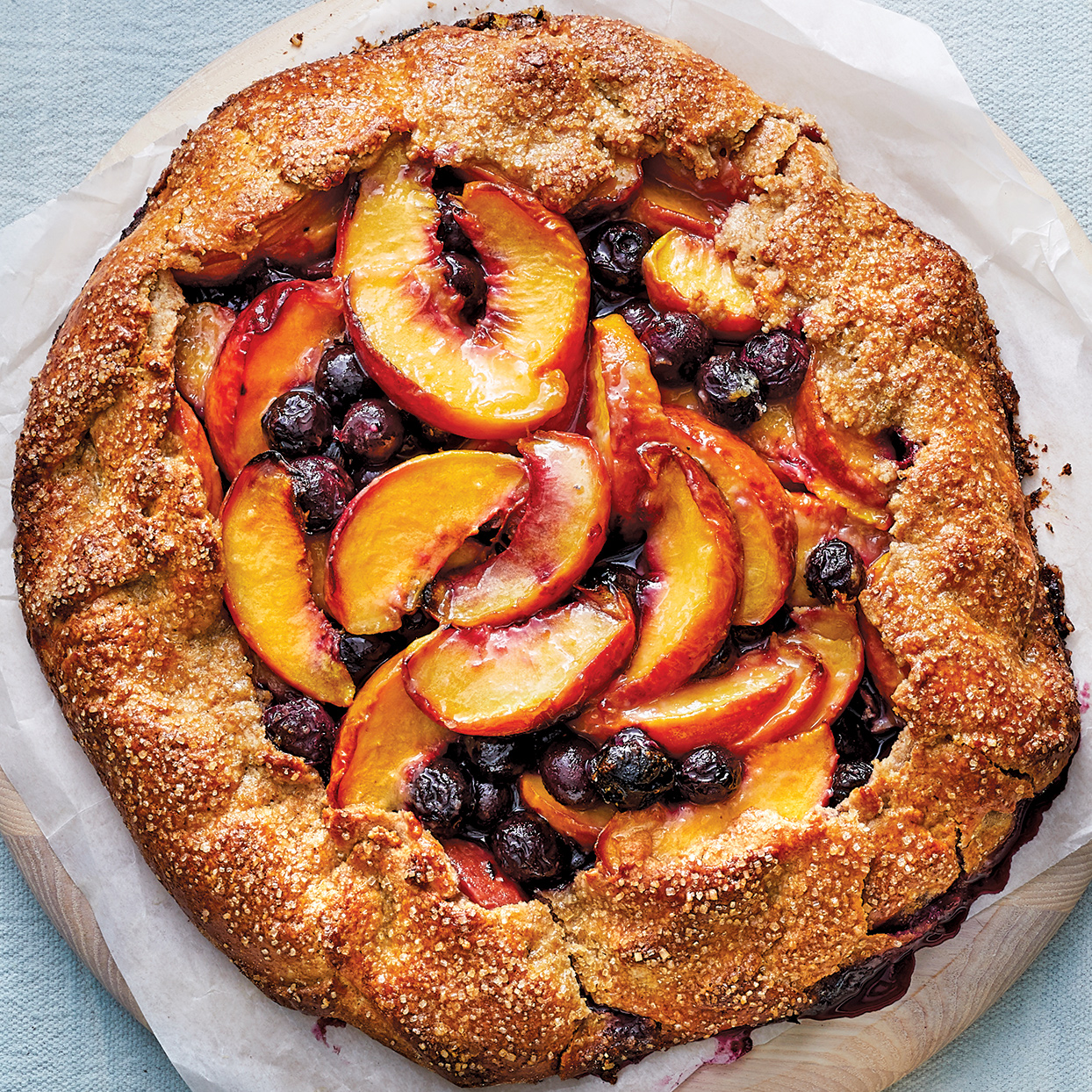With summery, bright fruit, this pie is a crowd- pleaser and pretty enough to be the centerpiece for a summer dinner party. The crust is tender, with a deeper flavor from the whole-wheat flour than you would get with a plain white-flour crust. Source: 400 Calorie Recipes