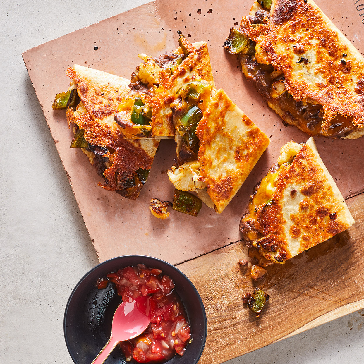 Poblano peppers add a touch of heat to these vegetarian quesadillas, but a sweet bell pepper is tasty, too, if you want something milder. Start these quesadillas in the oven and finish them off in a skillet for melty cheese and crispy tortillas.