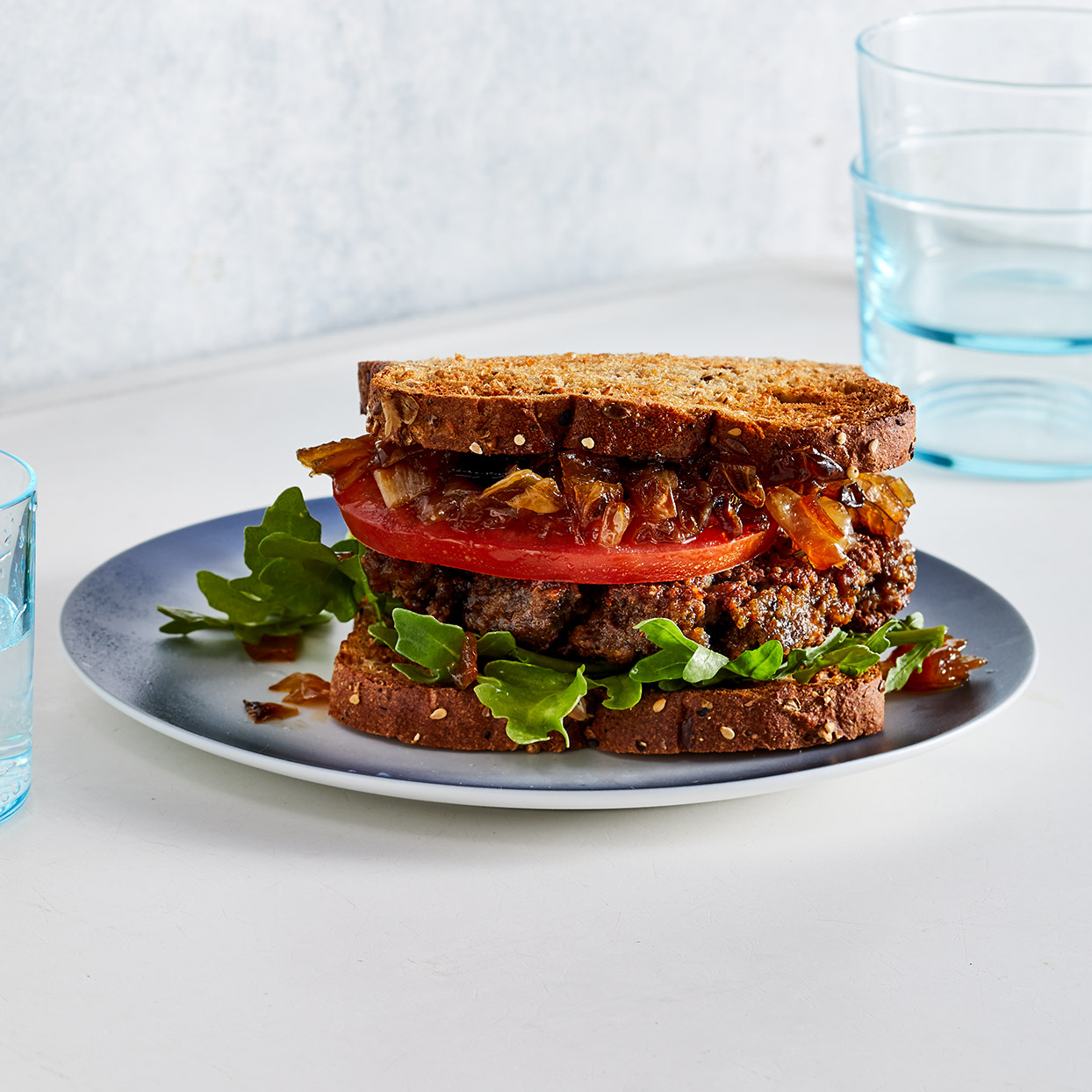 Learning how to make smashed burgers is as simple as its name. Smashing burgers into thin patties not only makes them quick-cooking, it also creates irresistible crispy edges. Topping them with the caramelized onion relish adds extra deliciousness. Source: EatingWell Magazine, March 2020