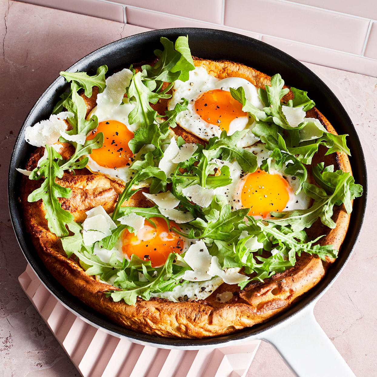 Also called a German pancake, this breakfast or brunch dish is delicious served with sweet or savory ingredients. Here, we make this Dutch baby recipe dinner-worthy by topping it with a fresh salad, cheese and fried eggs. Source: EatingWell Magazine, March 2020