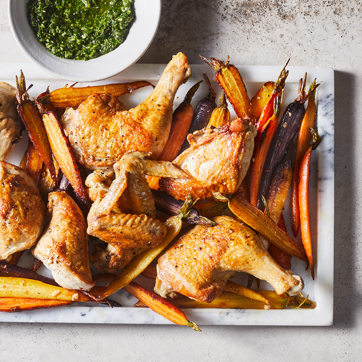 Nothing says comfort like a roasted whole chicken, but it can take a while to cook. Using parts instead puts this easy roast chicken on the weeknight menu. Fresh herbs, lemon juice and capers in this Italian salsa verde sauce brighten things up. Source: EatingWell Magazine, March 2020