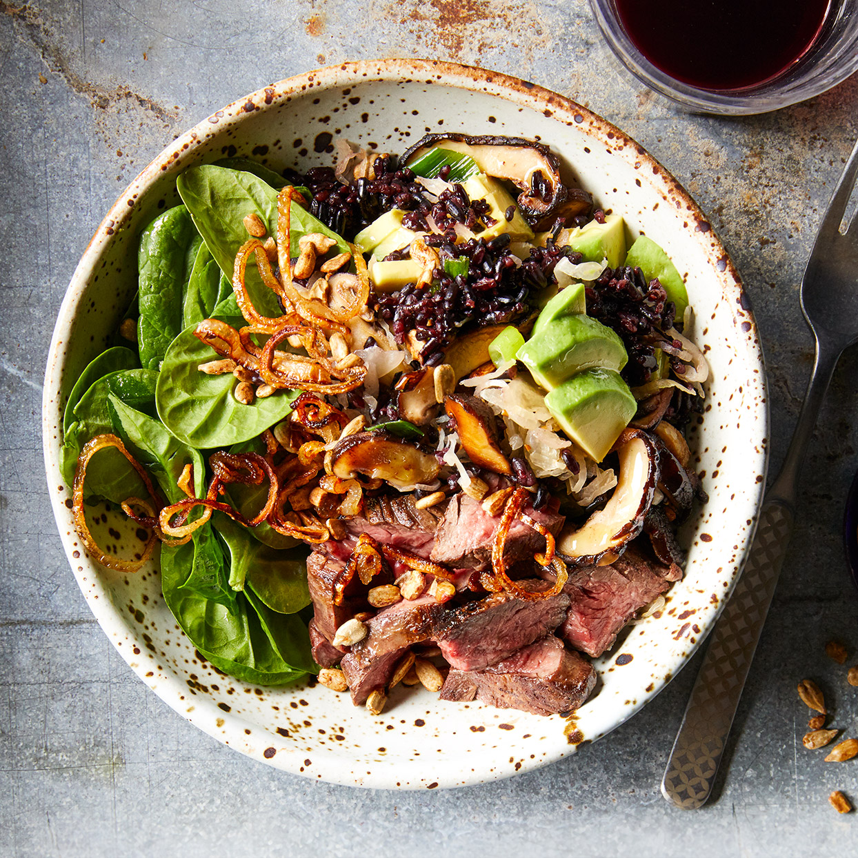This steak salad doesn't feature a typical dressing, but tangy kimchi, savory pan-fried shallots and lemon juice pack it with flavor. Forbidden rice helps add more color and nutrition to this tangy dish.