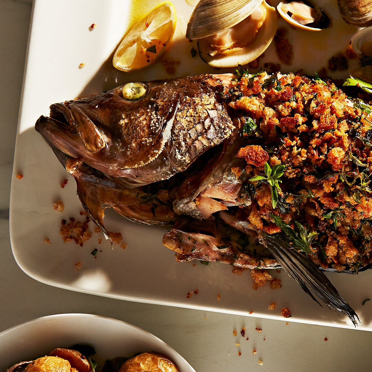 This whole fish smothered with herbs and buttery breadcrumbs is simple enough to let the flavor of the Mediterranean seafood shine through. If cleaning and prepping the fish for this sea bass recipe isn't your thing, most fish counters at larger markets will do it for you. Source: EatingWell Magazine, March 2020