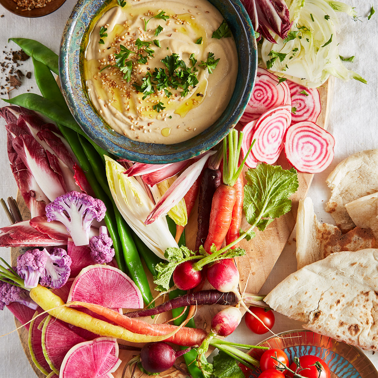 Super creamy with the nutty flavor of sesame seeds, this homemade tahini sauce recipe is a popular way to begin a meal in Cyprus. Serve with crudités and pita.