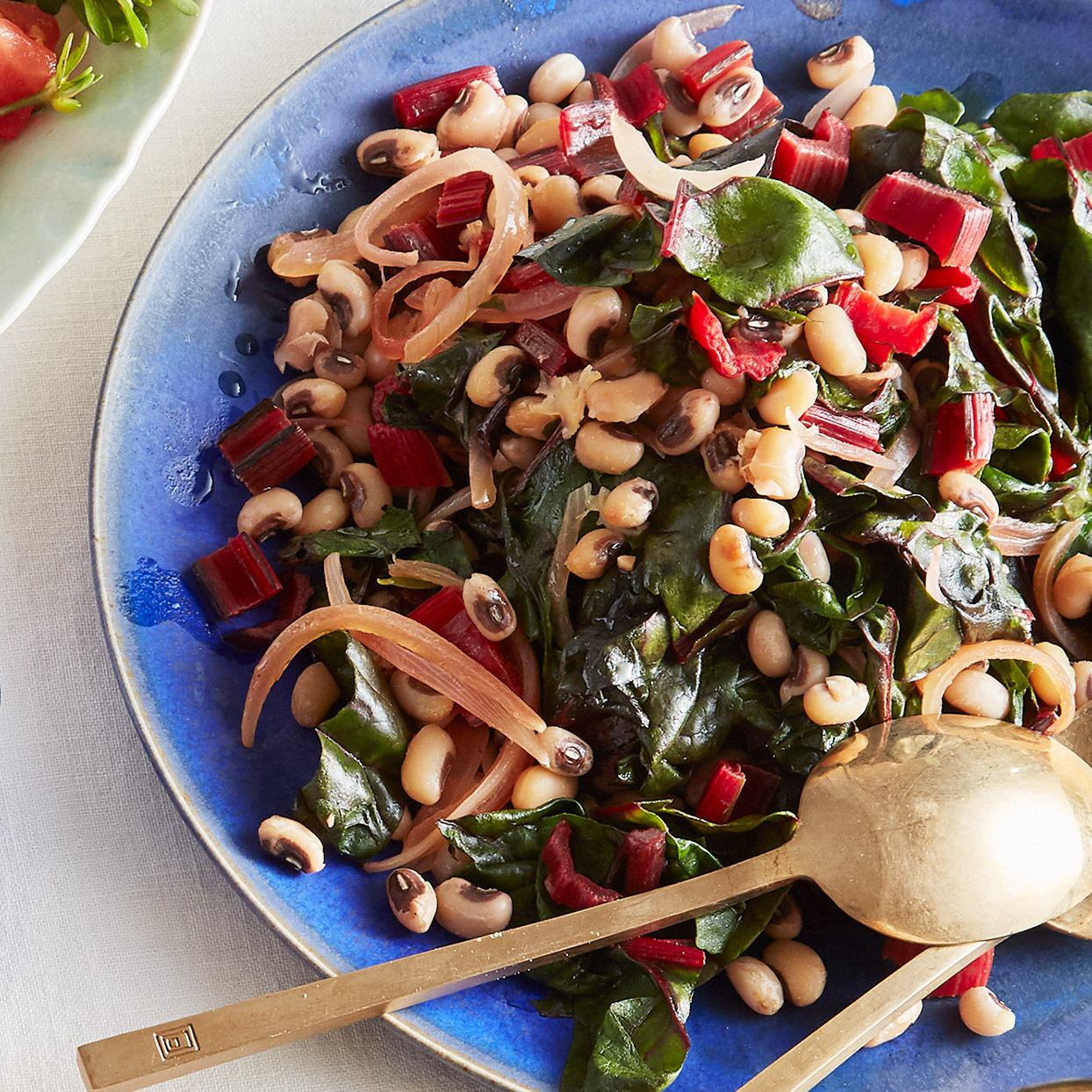 Two Cypriot specialties--good olive oil and fresh lemons--lend sunny flavor to this simple bean dish, served as a side in Cyprus. Chard adds a hearty touch. Top with a dollop of Greek yogurt, or nondairy yogurt to keep it vegan, for a meatless meal. Source: EatingWell Magazine, March 2020