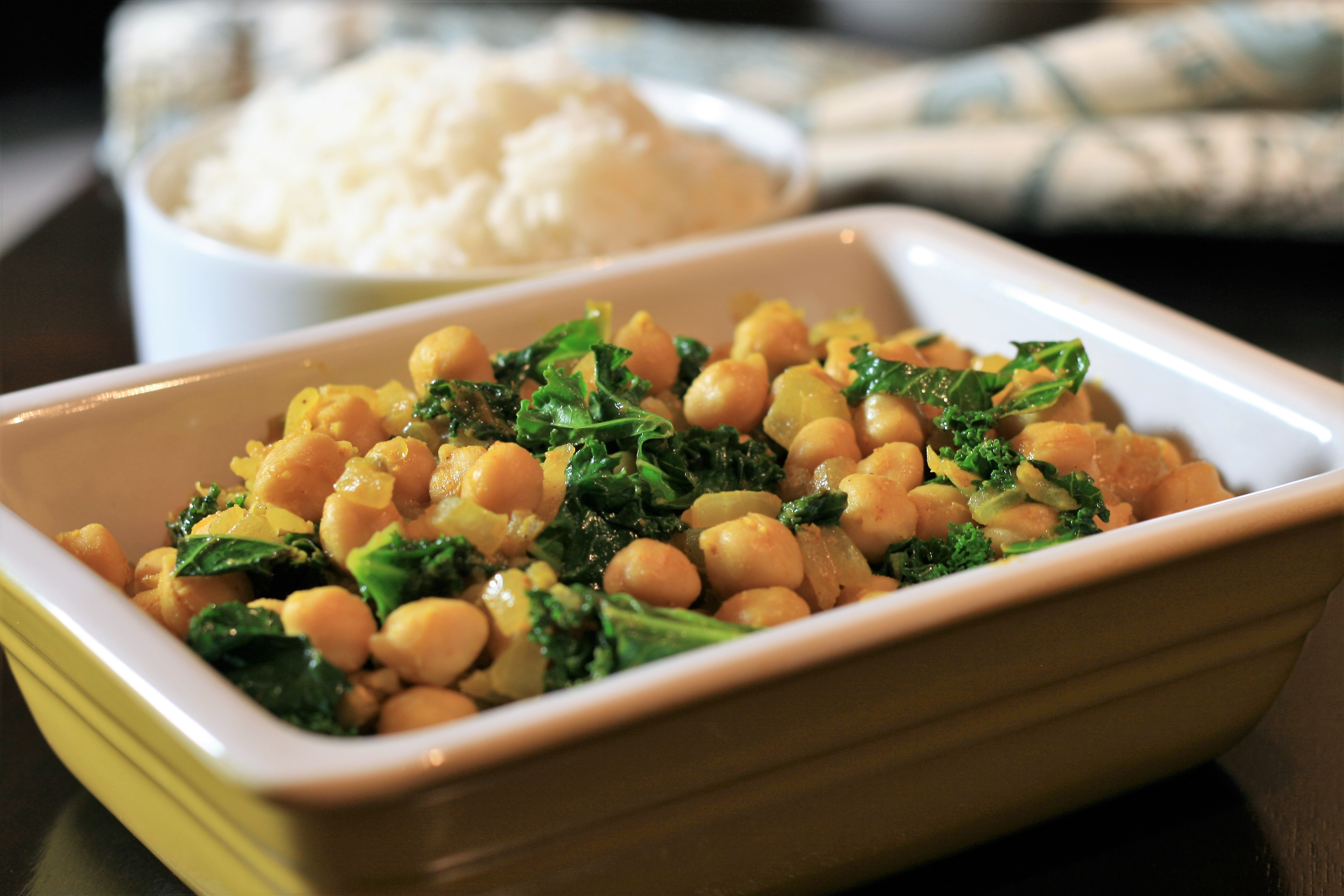 """Kale is sauteed with chickpeas and Indian spices. """"This is a delicious way to cook kale if you are running out of ideas, and it goes great with Indian dishes like dal,"""" says Lady Laff. """"Make sure not to overcook the greens!"""""""