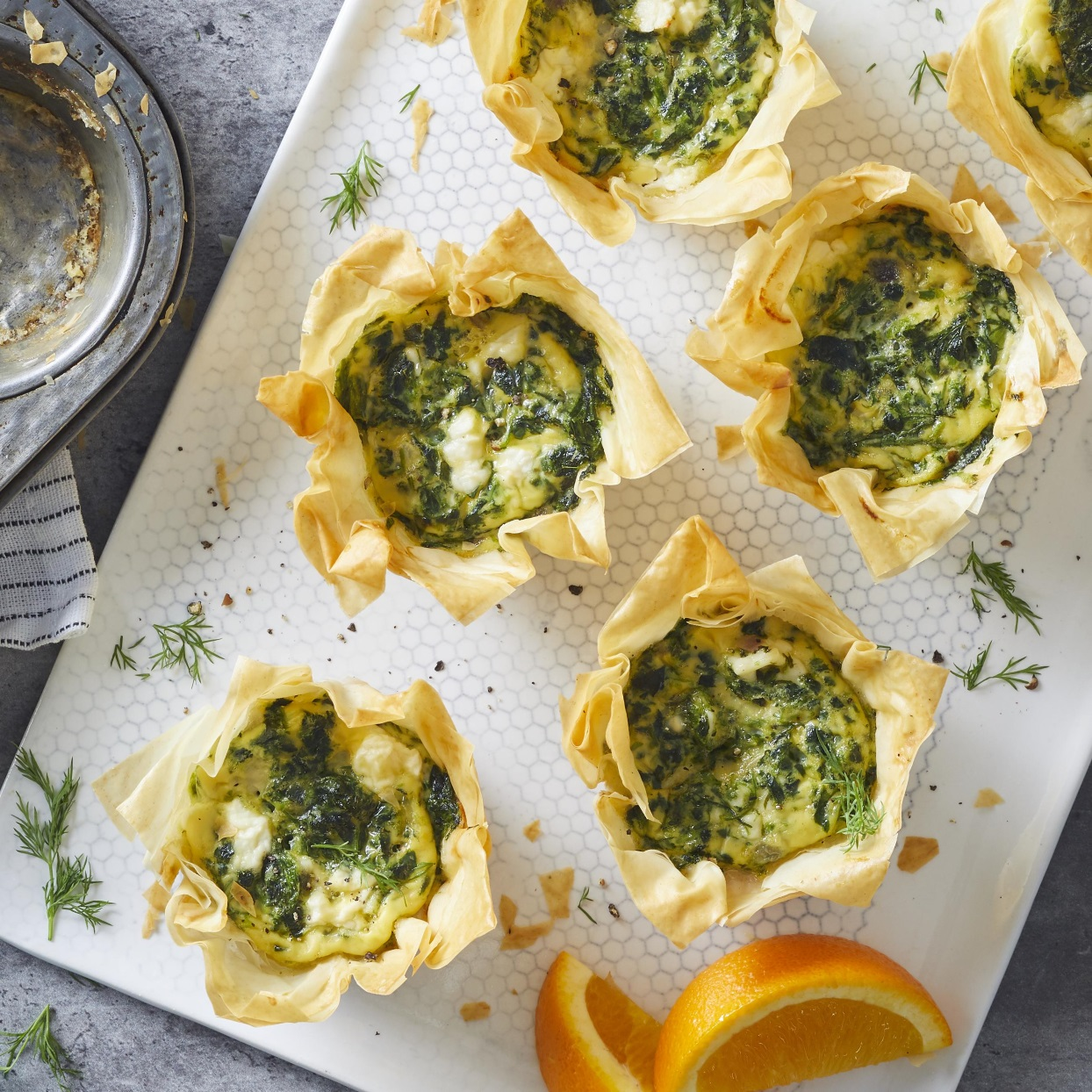 Spinach, onion and feta cheese flavor these Greek-inspired spanakopita omelets with crispy phyllo crusts.
