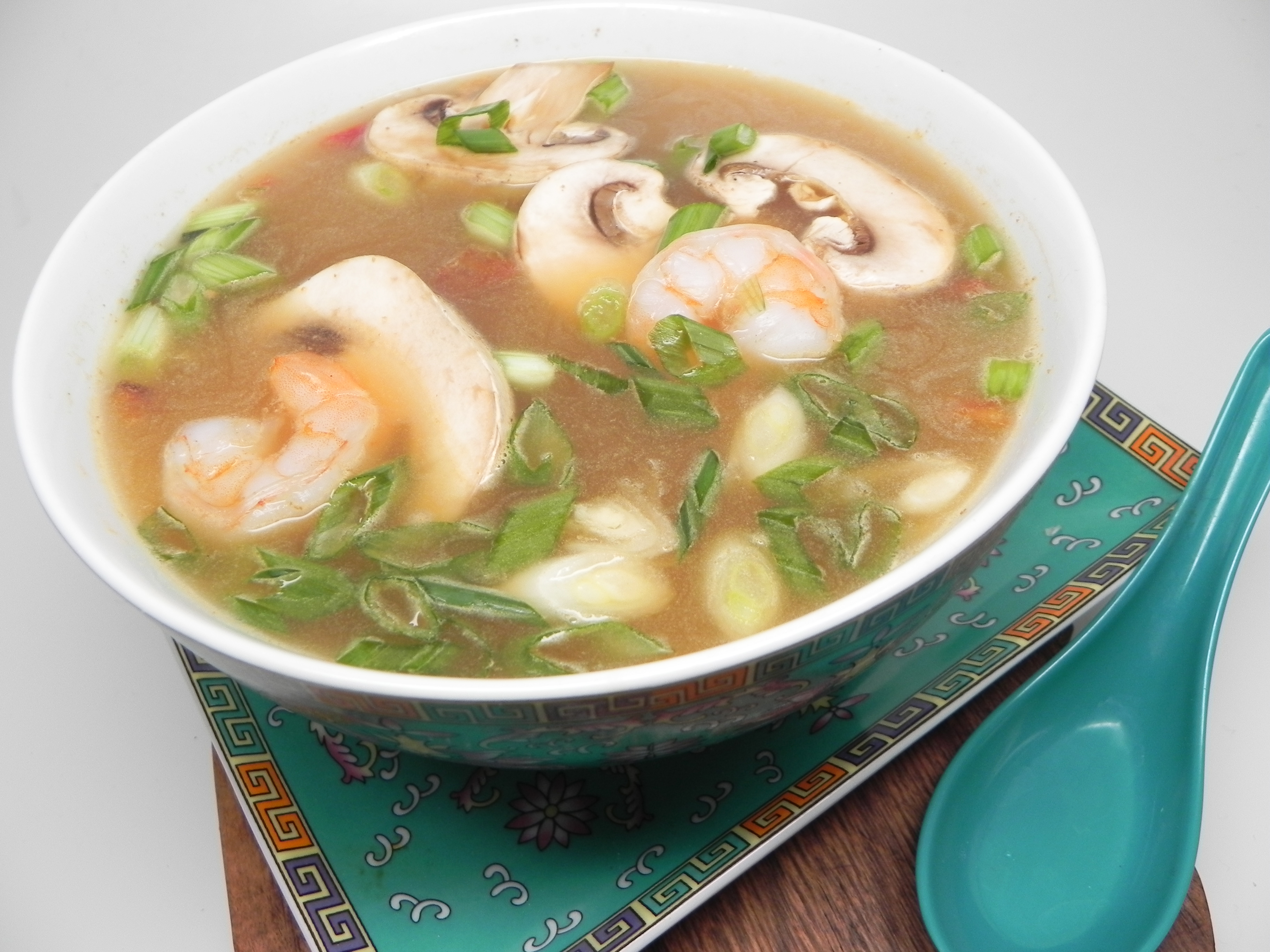 """Ready in 50 minutes, this homemade tom yum soup gets extra flavor from boiled shell-on shrimp and plenty of heat from Thai chile peppers. """"This homemade hot and sour soup is easier than most recipes you will find,"""" says Nader. """"I have simplified a sometimes complex recipe for those like me who can have a hard time finding some of the original ingredients. This is my favorite recipe."""""""