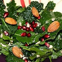 kale salad with pomegranate sunflower seeds and sliced