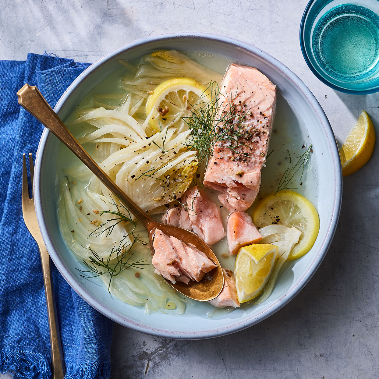 This poached salmon recipe uses an aromatic broth to infuse the fish with flavor while keeping it moist. Cook it with the skin on and keep the simmer gentle to ensure the fish stays intact. If you can't find a fennel bulb with its greens still attached, don't panic. Just grab some dill to use instead. Source: EatingWell Magazine, April 2020