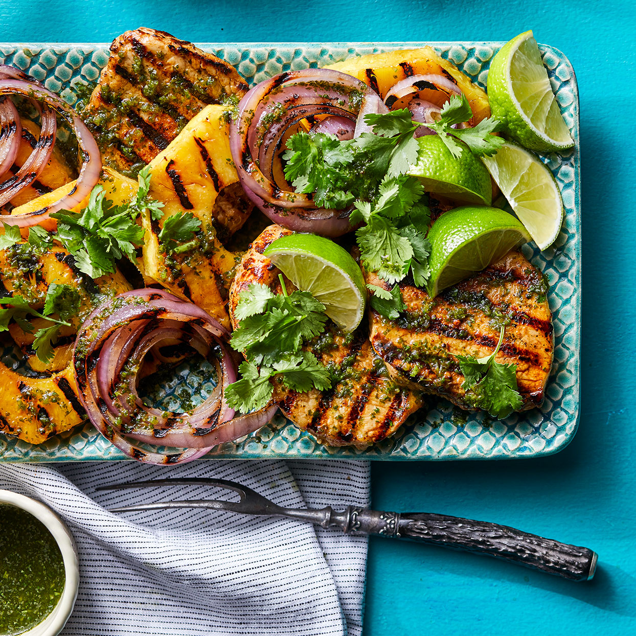 Never grilled pineapple? Get ready to be wowed. It caramelizes beautifully for a deeper flavor. Plus it's a totally tasty match with a grilled pork chop, cilantro and a little heat from serranos.