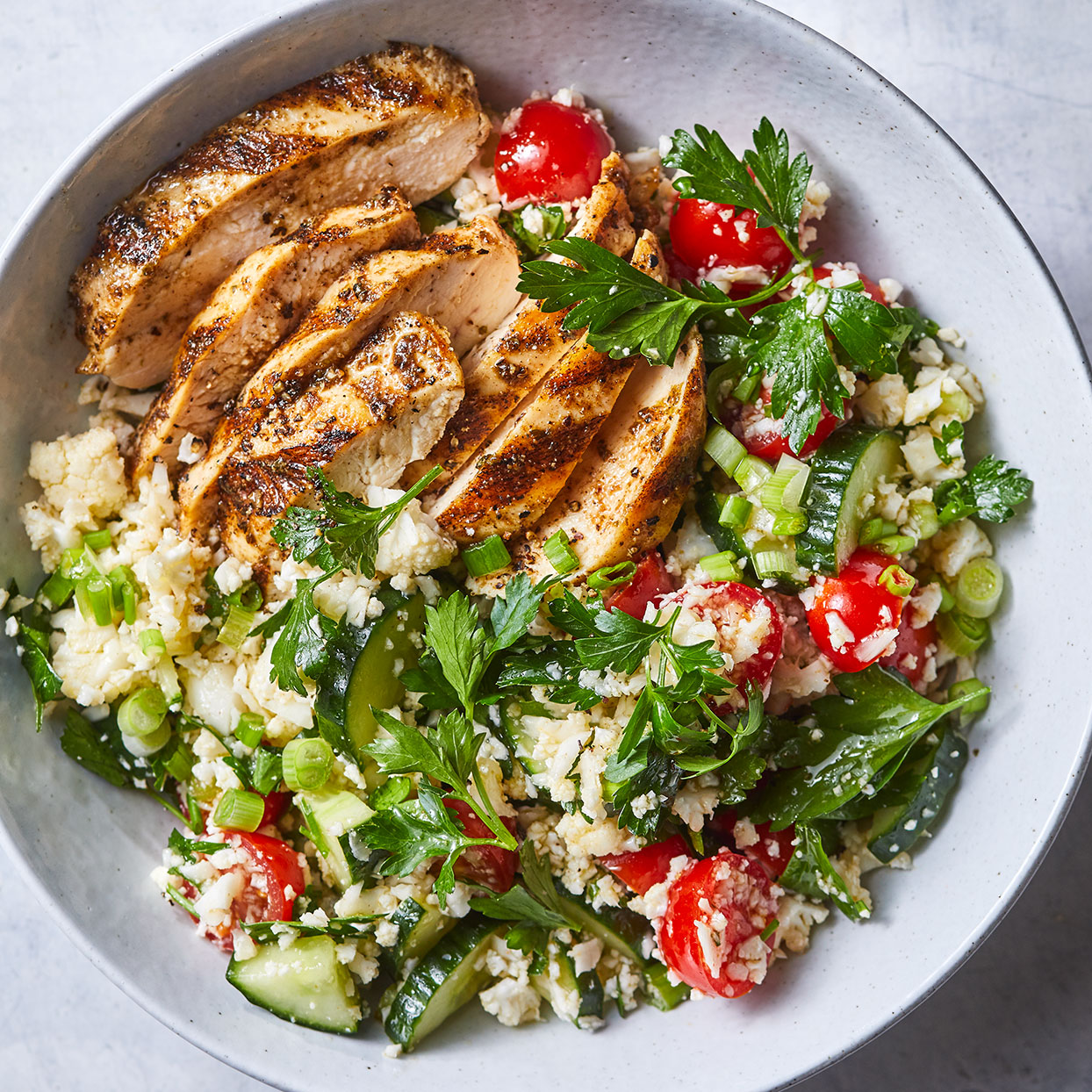 Chicken breasts on the grill have a smoky flavor that's enhanced with an easy spice rub. We chose flat-leaf parsley in this salad because it has a stronger herbal taste than its sometimes-bitter curly counterpart. Source: EatingWell Magazine, April 2020