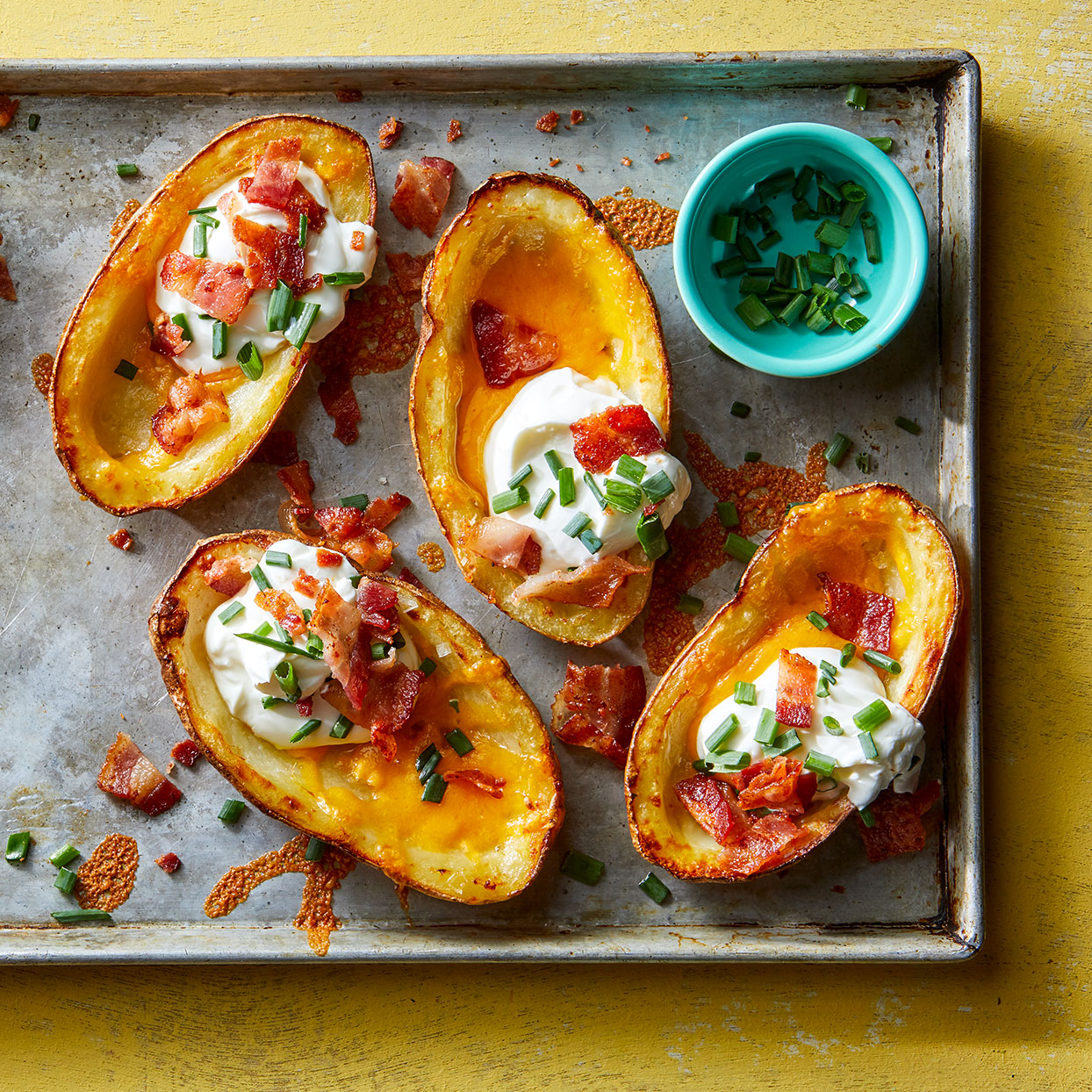 Serve these crispy baked potato skins as a side or cut them into 1-inch pieces and serve as an appetizer. Refrigerate or freeze the potato flesh to make mashed potatoes another night.