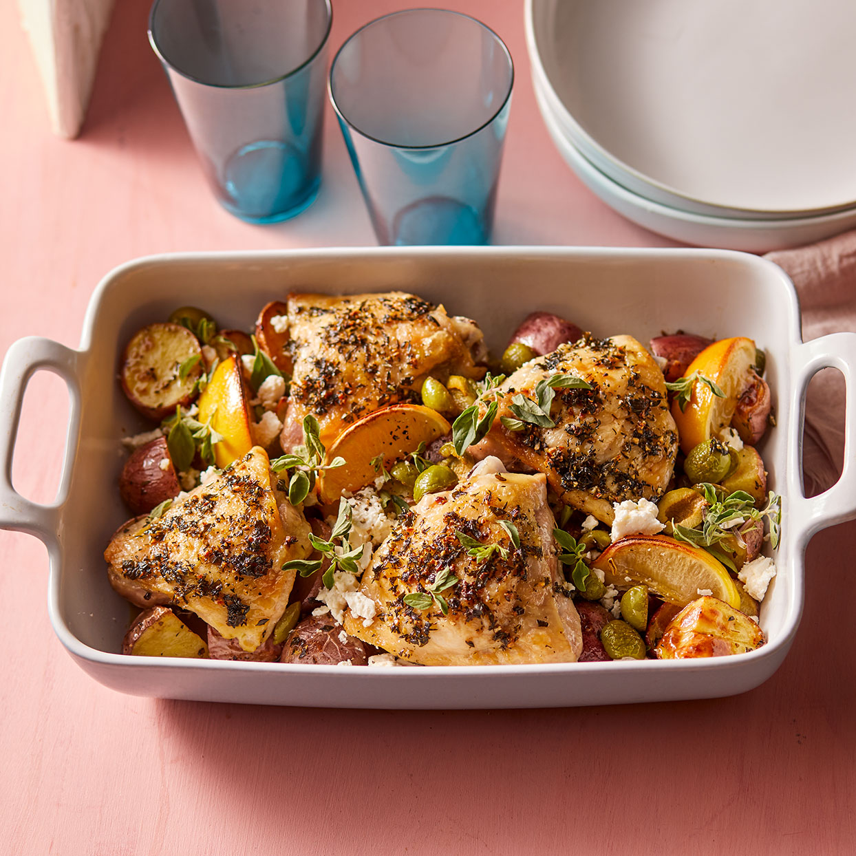 Roasting everything in one pan melds the flavors. The herby baked chicken absorbs the briny taste of the olives and the potatoes cook in the chicken drippings, making them extra savory.