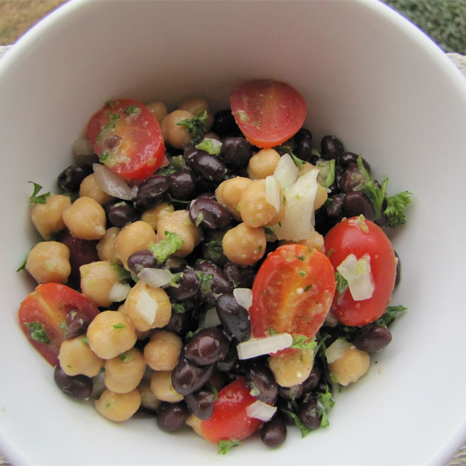 Ready in 25 mins                           If you prefer your salad with even more beans, this Middle-Eastern-inspired recipe is a great one to try. It features garbanzo beans, black beans, mint, parsley, onion, and grape tomatoes and a quick, flavorful blender dressing withjalapeno peppers, garlic, olive oil, lemon juice, and apple cider vinegar.