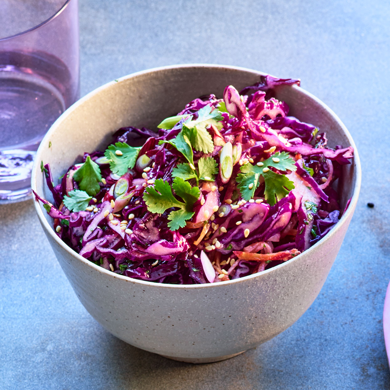 Combining a trio of purple vegetables--cabbage, carrots and daikon--makes for a stunning slaw recipe. It would be equally delicious tossed with a classic creamy dressing. Source: EatingWell Magazine, April 2020