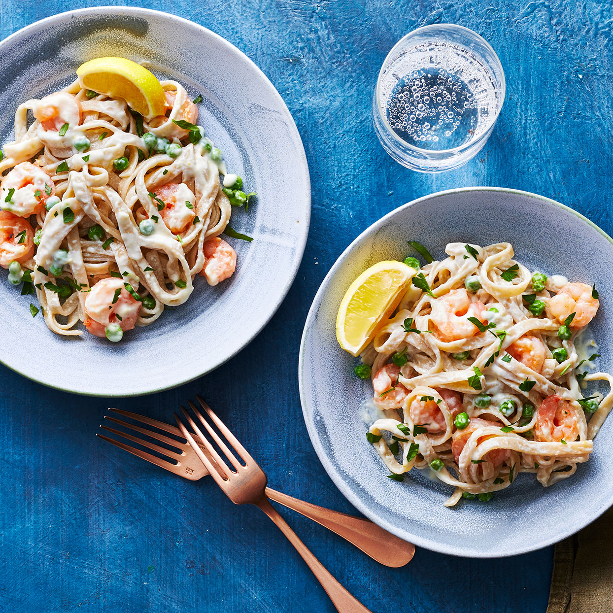 This bright and lemony shrimp pasta dish was inspired by traditional Alfredo but comes in at only a fraction of the fat and calories. Reduced-fat cream cheese adds body to the sauce, while Parmesan cheese adds its signature robust flavor. Source: EatingWell.com, March 2020