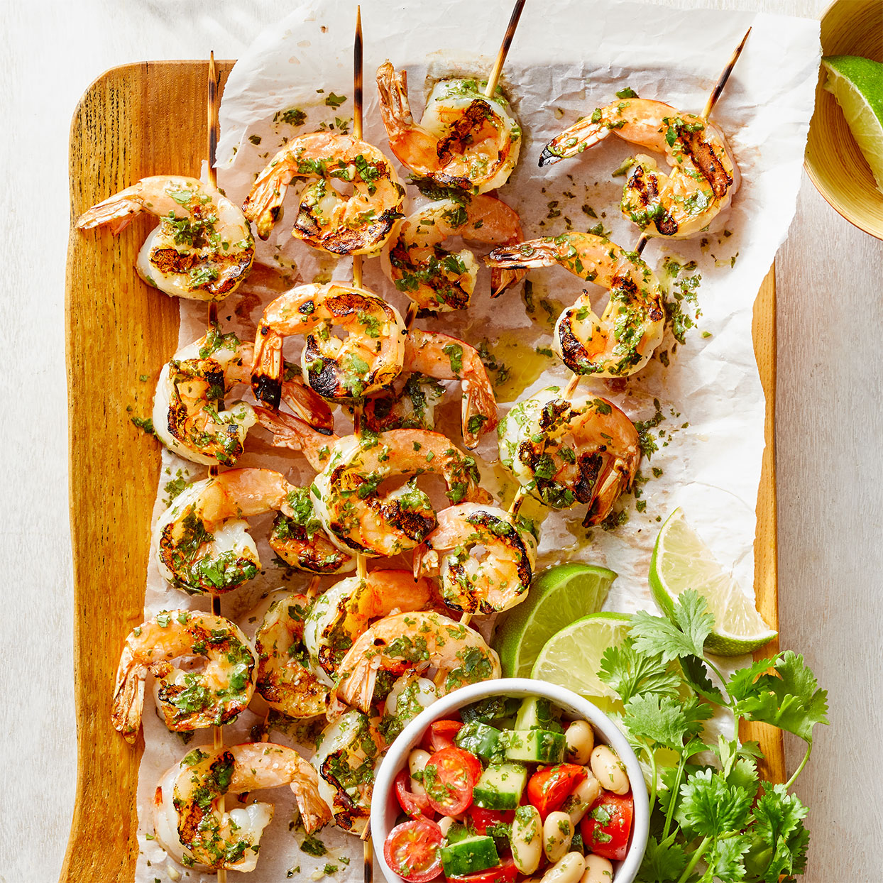 Fresh cilantro, parsley, and lime juice make a tangy green salsa that adds lively flavor to this easy grilled shrimp recipe. Source: Diabetic Living Magazine, Spring 2020