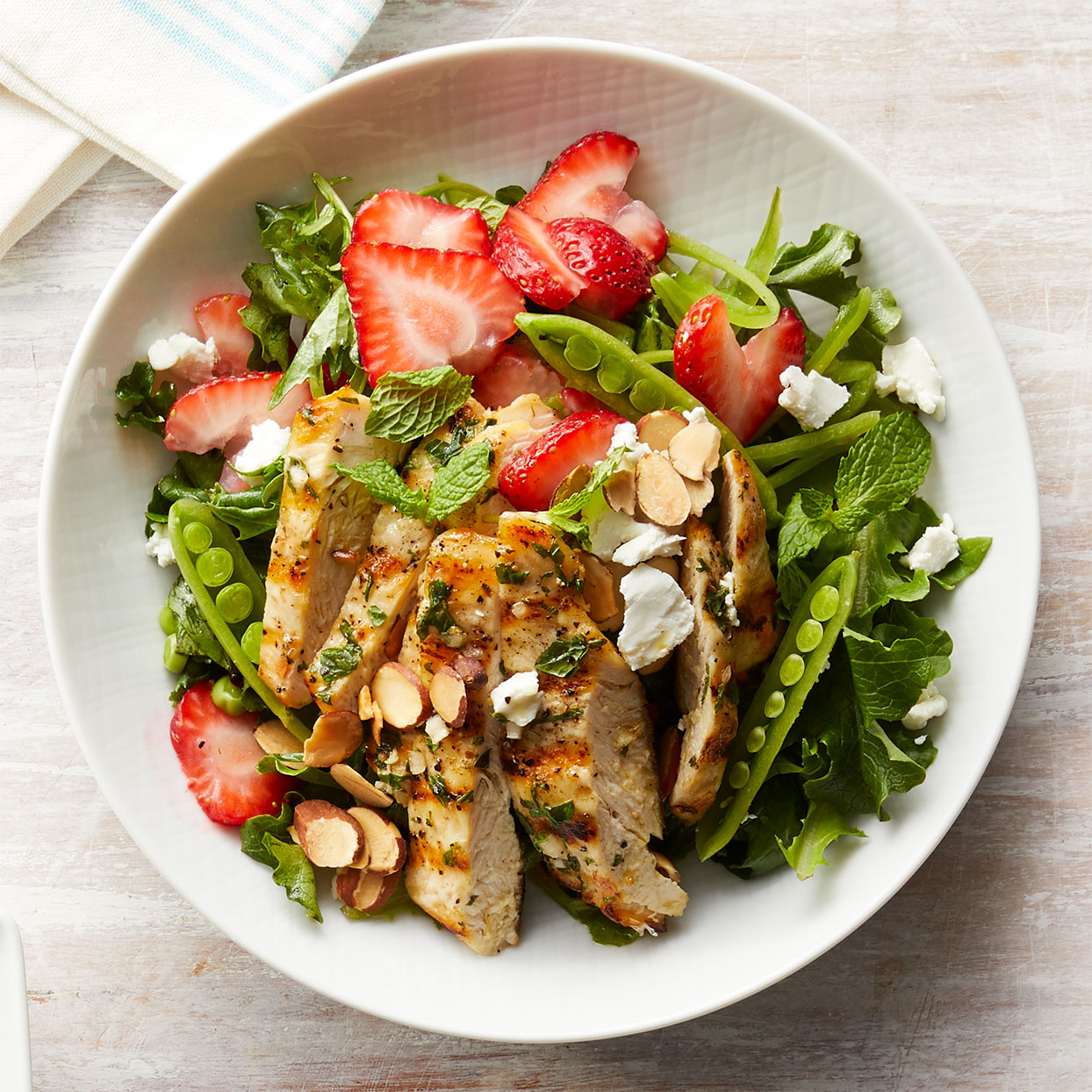 Fresh mint appears twice here: finely chopped mint in the dressing and whole mint leaves in the strawberry chicken salad, tossed with tender greens. Source: Diabetic Living Magazine, Spring 2020