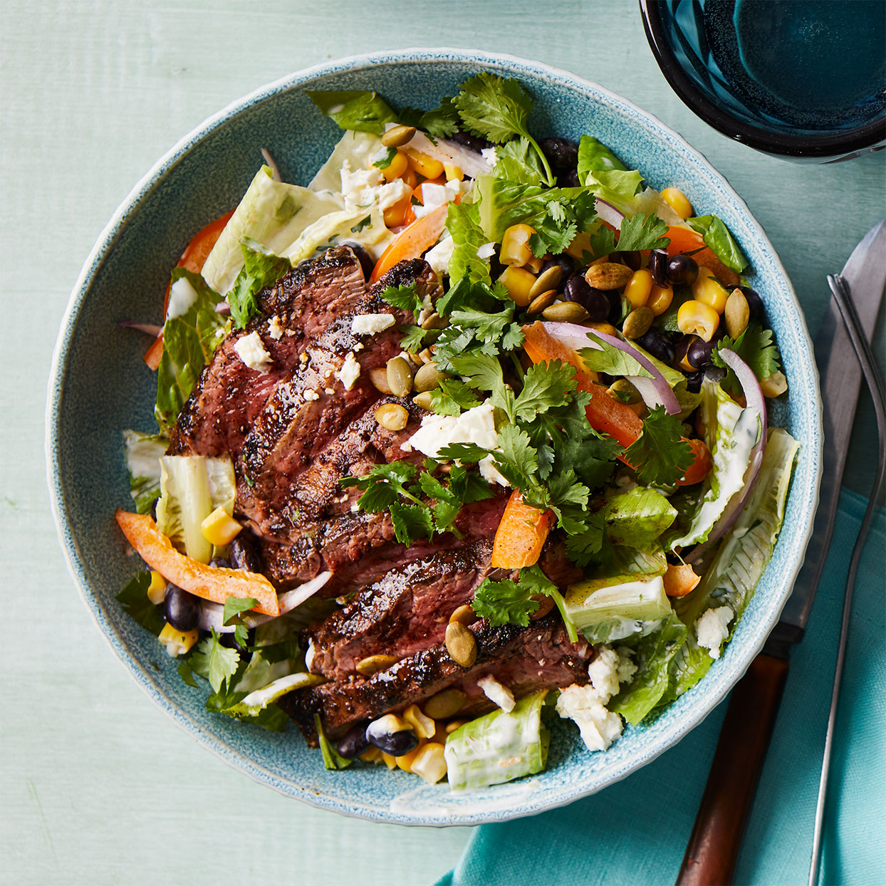 Transform steak into a nutritious meal by serving it atop this lively Southwest-inspired salad recipe. If you make the dressing when you marinate the steak, this meal comes together quickly.Source: Diabetic Living Magazine, Spring 2020