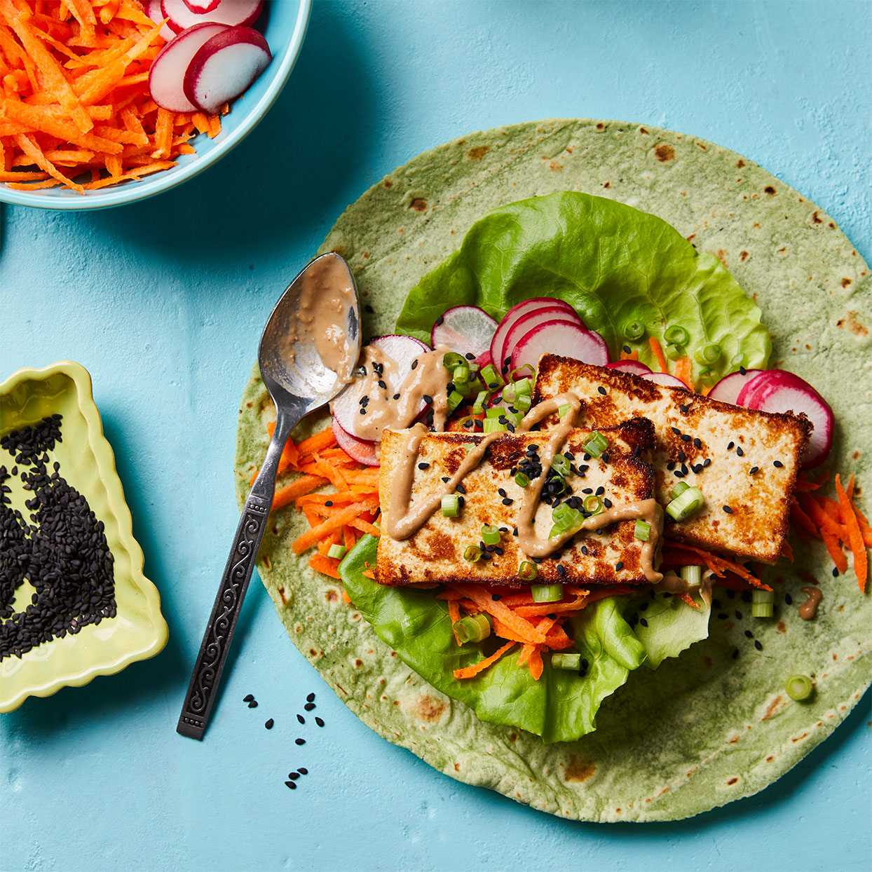 A tangy tahini-ginger-soy mixture both marinates the tofu and serves as a sauce for this colorful veggie wrap recipe. Look for spinach tortillas for an additional pop of green. Source: Diabetic Living Magazine, Spring 2020