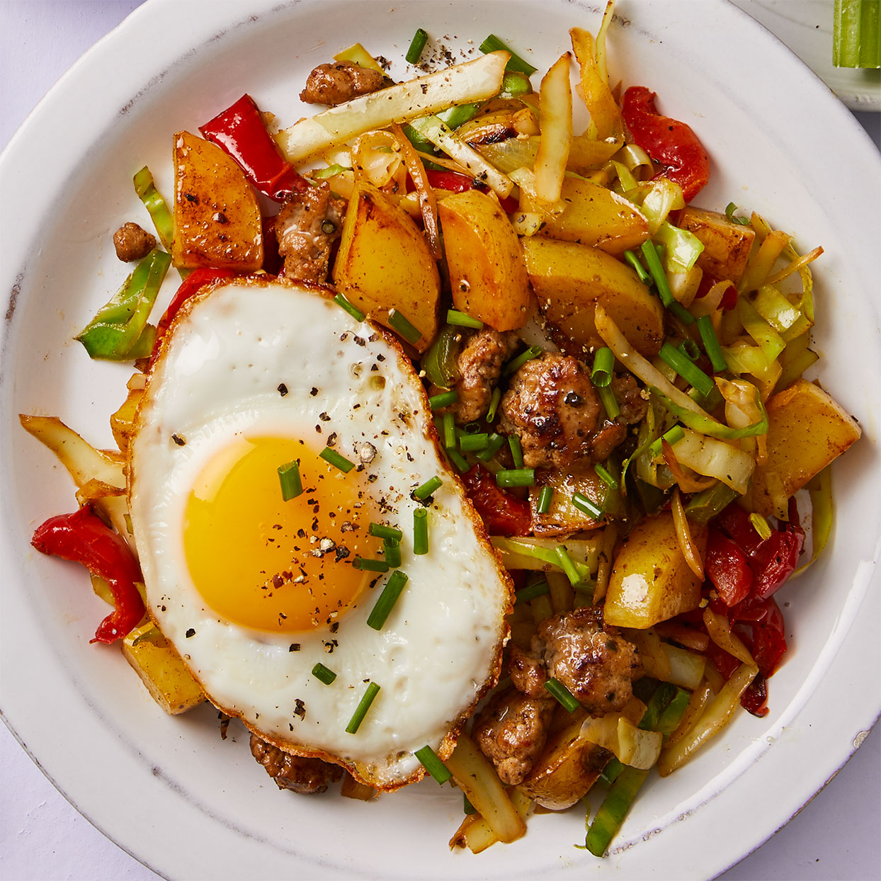 Leftover cooked potatoes and peppers form the base of this quick weeknight meal for one. Alternatively, use frozen cubed hash browns and and bell pepper-onion stir-fry mix. Source: Diabetic Living Magazine, Spring 2020