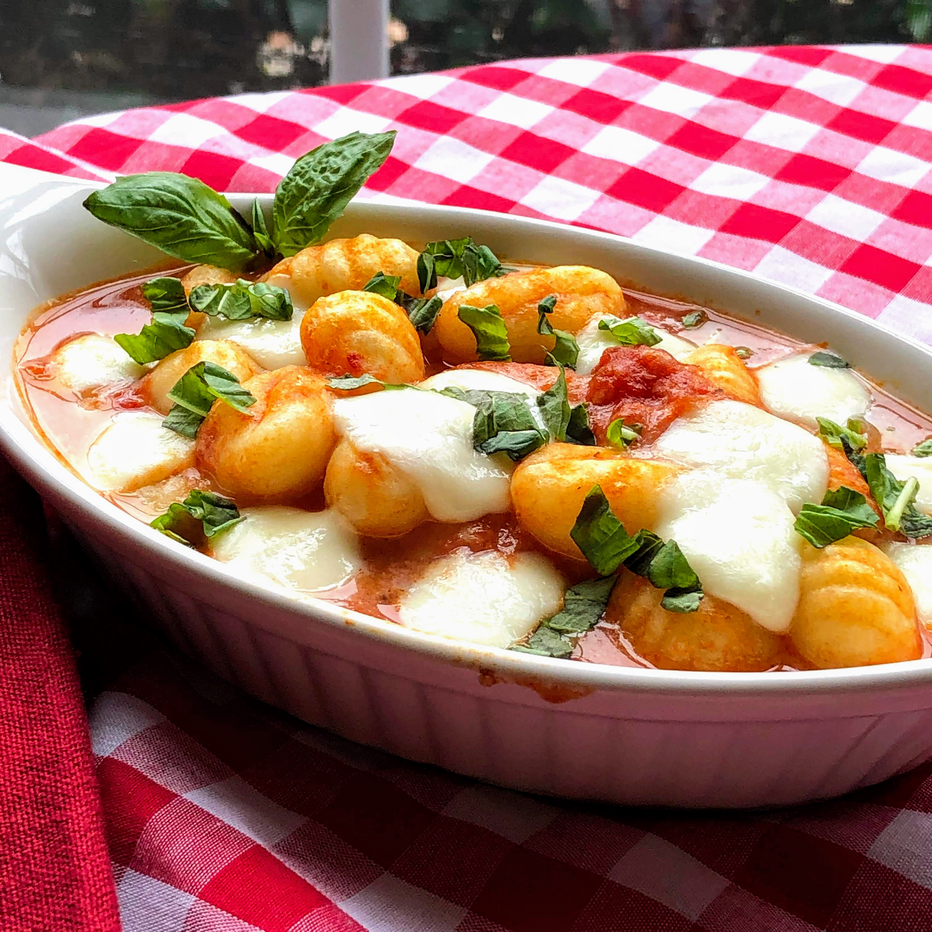 "This classic Italian dish starts with a package of potato gnocchi and canned crushed tomatoes. ""Known as 'gnocchi alla sorrentina,' this classic Italian pasta dish uses simple ingredients and tastes delicious,"" says saretta. ""Use homemade or store-bought gnocchi."""
