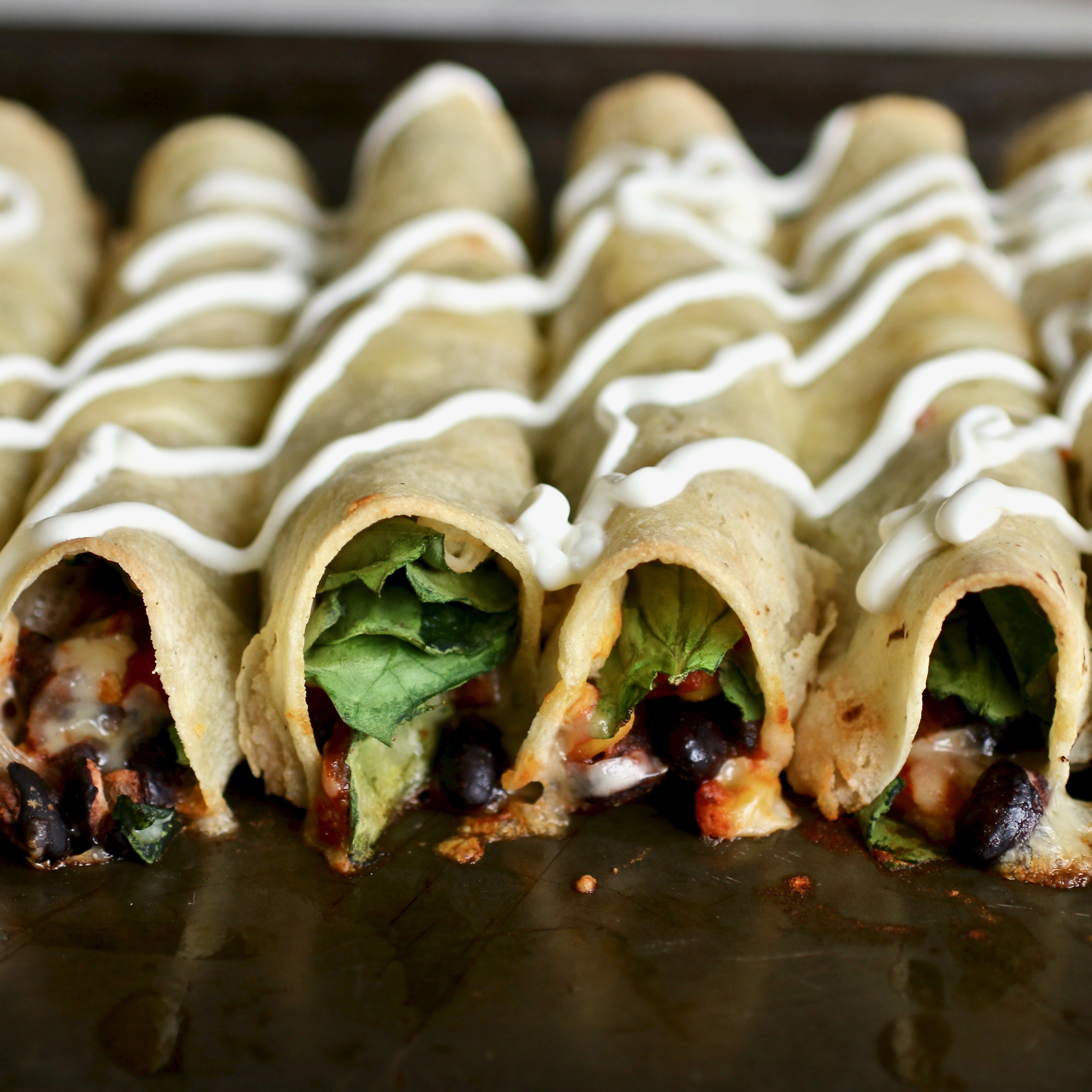 "This healthy vegetarian flautas recipe features a jar black bean and corn salsa, a couple cans of black banes, fresh spinach, and Monterey Jack cheese. KIMBERMARIE calls it, ""A vegetarian take on a classic Mexican dish. These delicious flautas are baked until crispy using cooking spray instead of vegetable oil to ""fry"" the tortillas. Topped with plain Greek yogurt for a wholesome and tasty alternative to sour cream."""