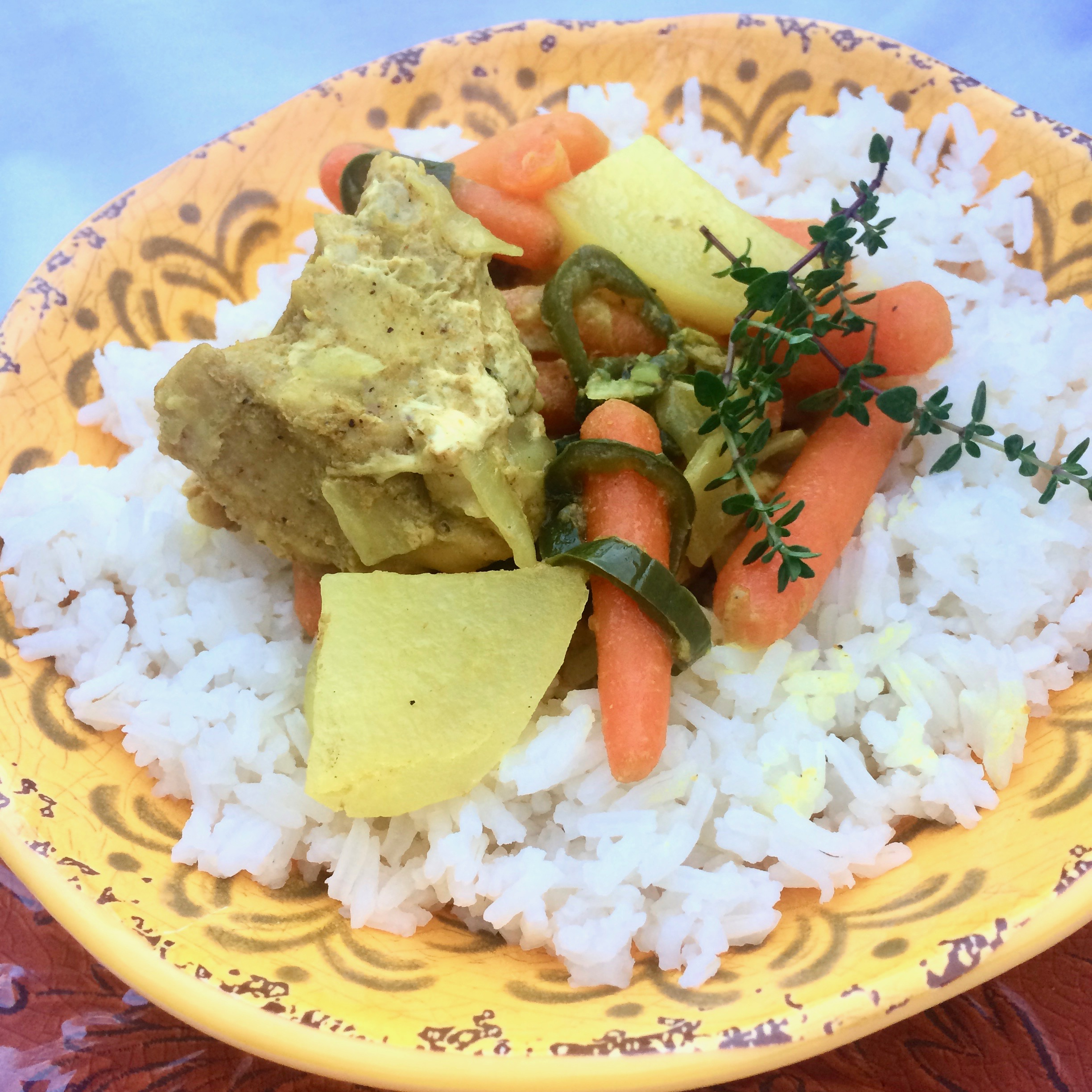 """This Jamaican chicken curry with potatoes and carrots is quick and easy to make in the Instant Pot. """"If you can't go to Jamaica, why not bring Jamaica to you with this lively chicken dish!"""" says Bibi. """"Jamaican curry usually contains allspice, so look for a blend that has it, or make your own. Even with potatoes in the dish, steamed basmati rice is a great add-on, but feel free to leave it out, or use cauli rice to cut back on the carbs."""""""