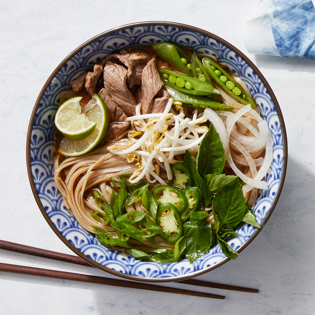 Traditional Vietnamese beef pho involves simmering whole herbs and aromatics for hours to achieve a rich, clear broth with a deep flavor; this shortcut version simmers ground spices for just 15 minutes, yet still achieves a savory, rich broth.
