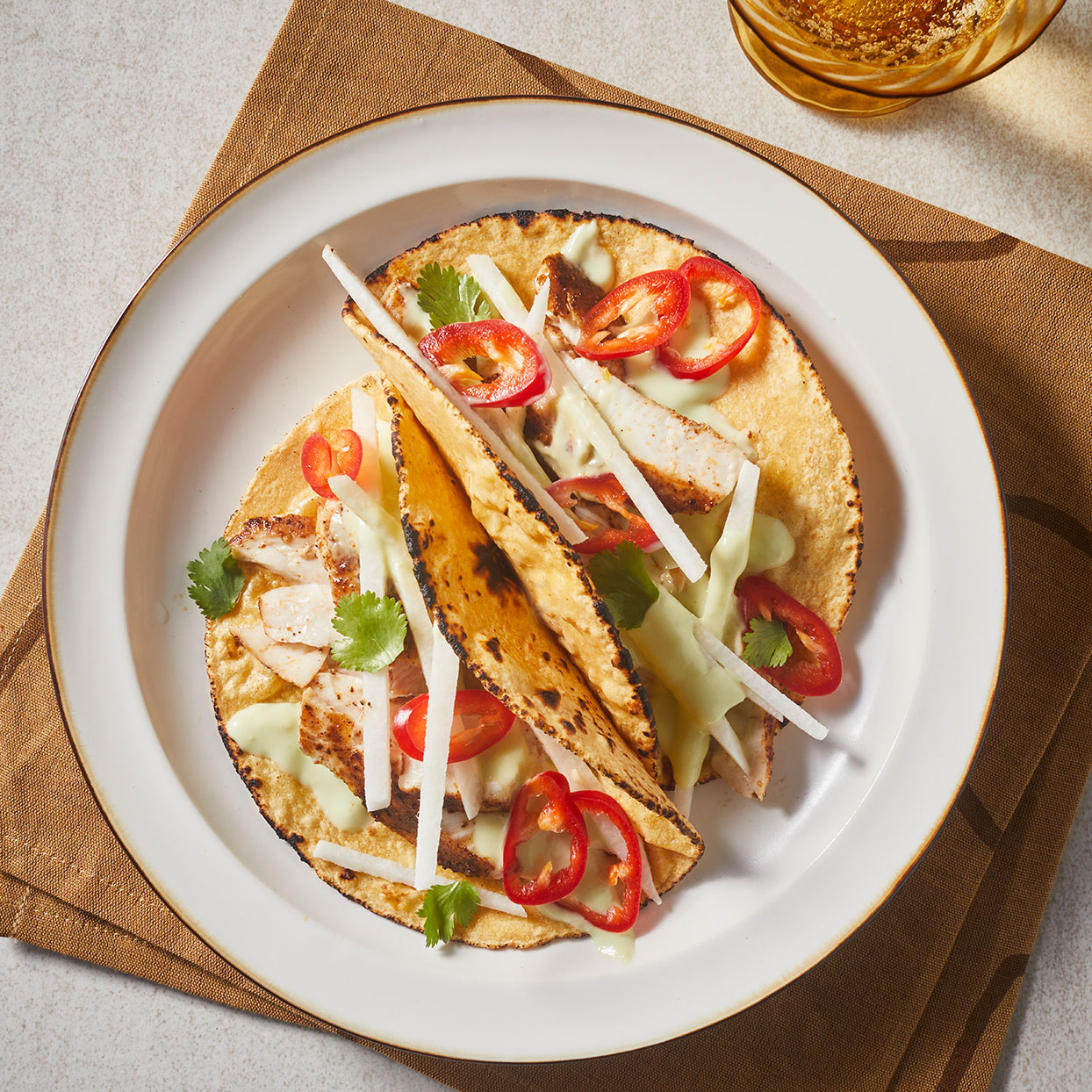 In this mahi-mahi fish taco recipe, chili-coated fish gets a lovely crust from the hot pan. The creaminess of the avocado sauce complements the crisp crunch of the jicama, and it's all pulled together in 20 minutes. Source: EatingWell.com, March 2020