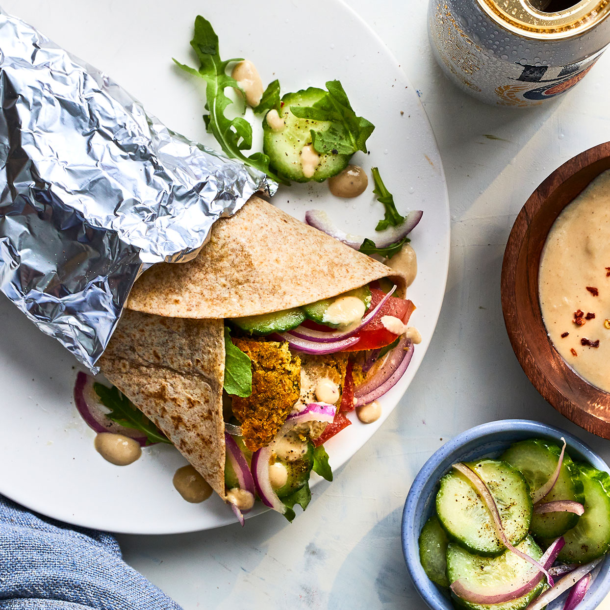 This street-style falafel sandwich is herbaceous, tangy and rich. The falafel gets nice and crispy in the oven while the veggies inside keep it simple and fresh. Make the tahini sauce (see Associated Recipes) ahead of time for easy prep. Wrapping the sandwich in foil makes it a perfect bring-along lunch and helps hold it together for eating on the go. Source: EatingWell.com, March 2020