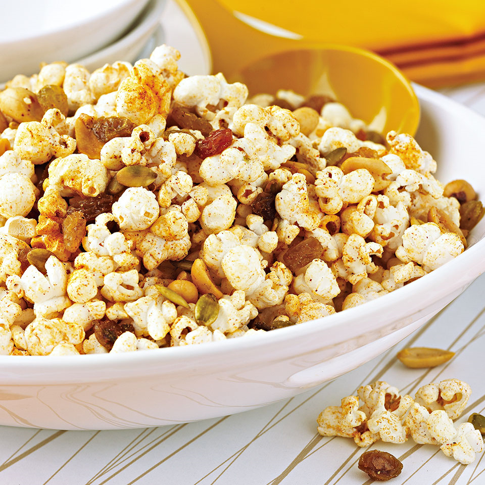 Taco seasoning mix gives this fruit and nut popcorn snack south-of-the-border sizzle.