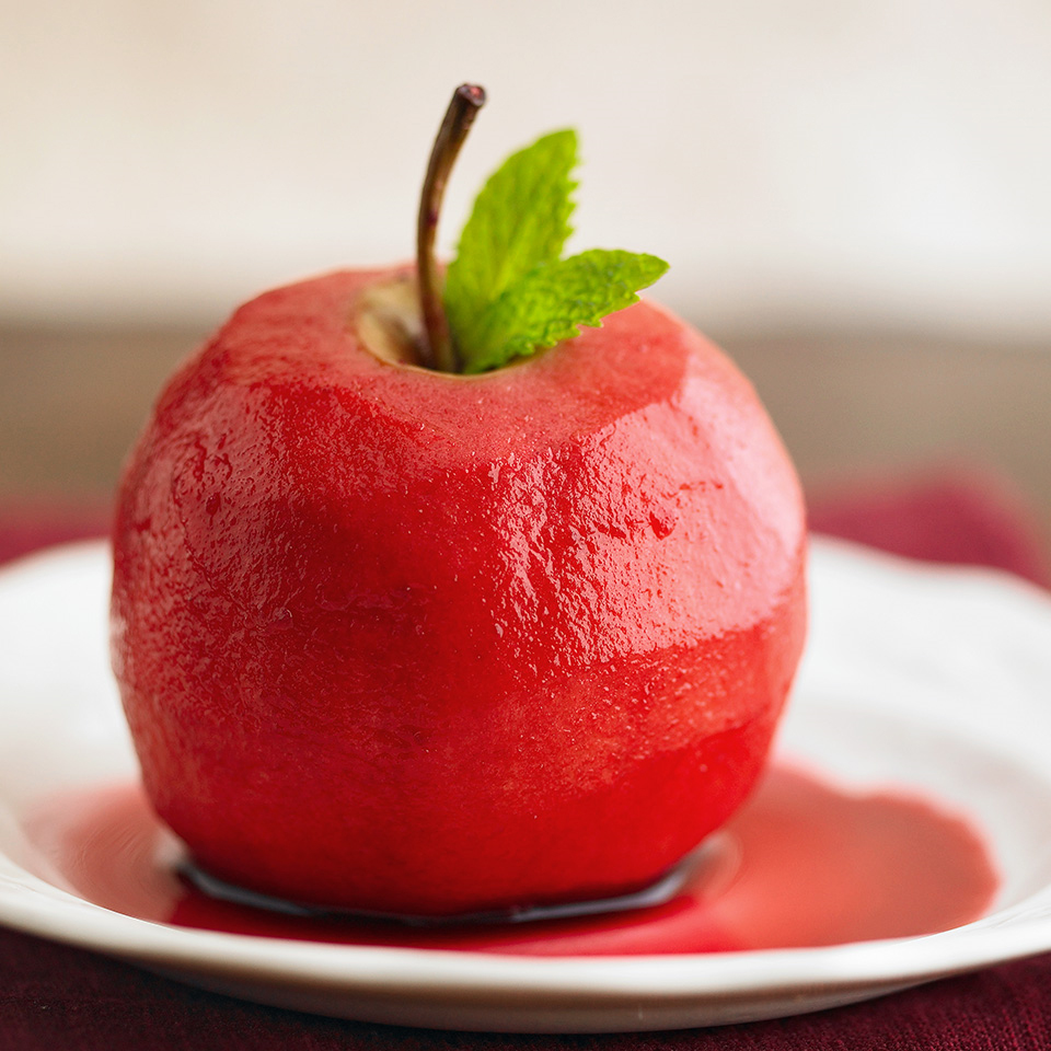 The vibrant red cherry-wine sauce serves as a scrumptious low-calorie, fat-free flavor accent to the tart-sweet baked apples in this recipe.
