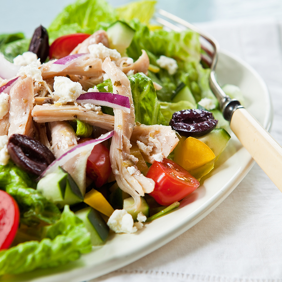 Transform leftover chicken into a fresh Mediterranean-style salad with bottled vinaigrette, plenty of veggies, feta and olives.