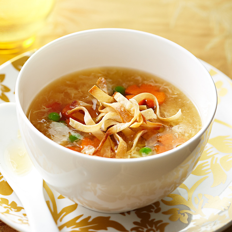 Carrots, baby sweet peas, and green onions are added to the traditional egg drop soup in this recipe.