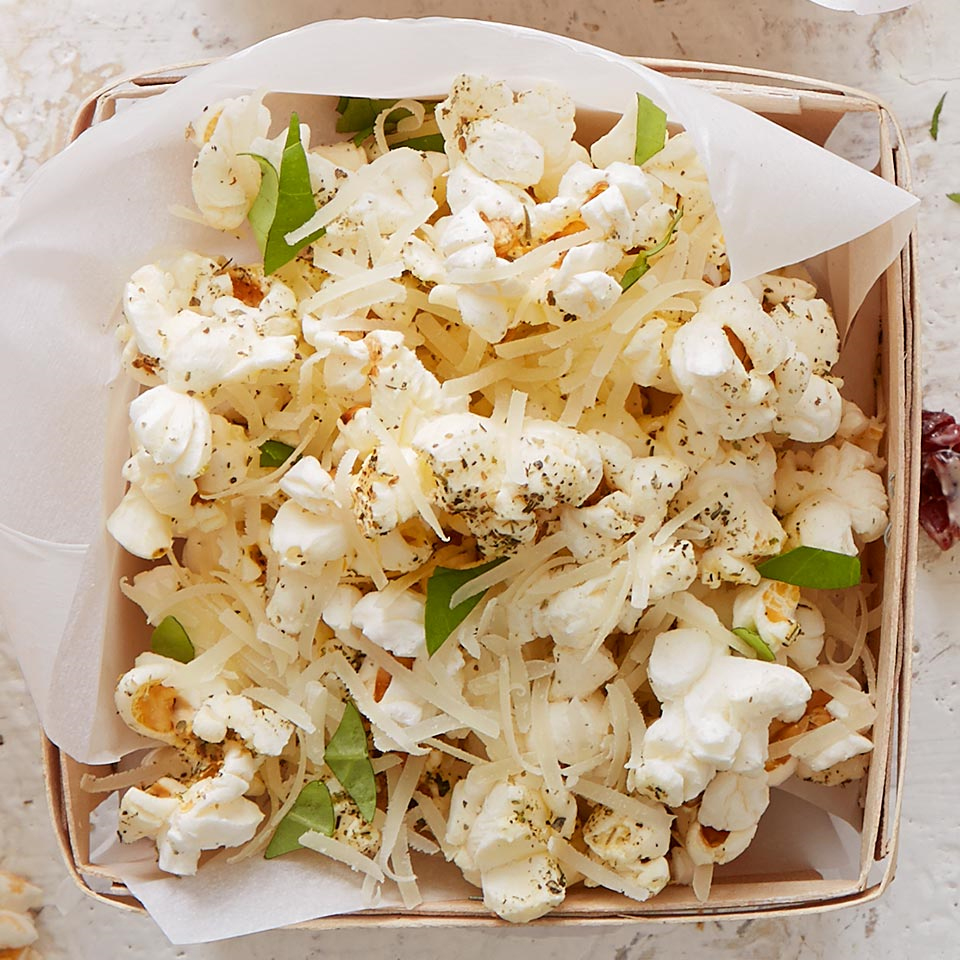 This healthy air-popped whole-grain snack gets jazzed up with a dash of herbs and cheese.